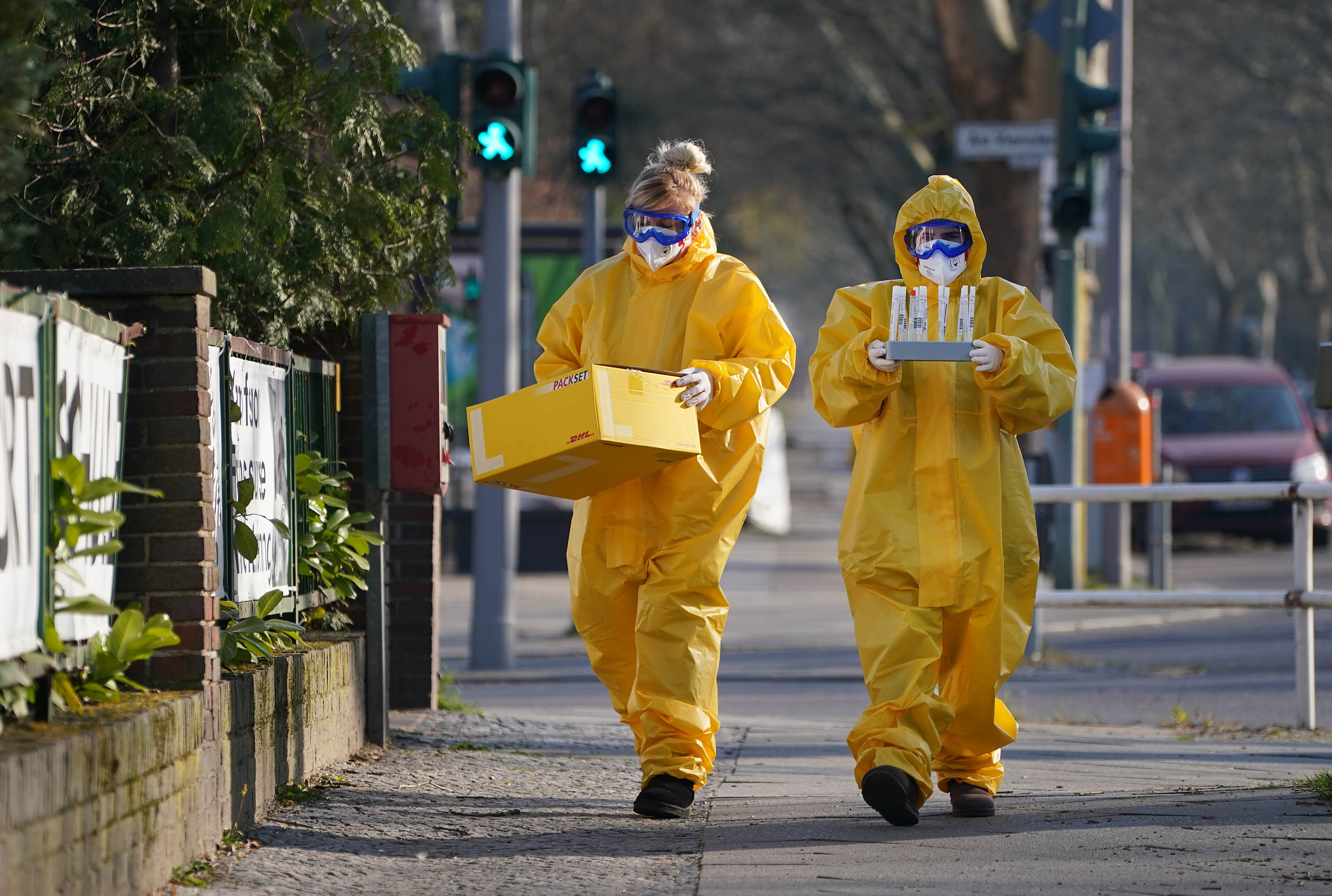Workers return to a medical practice after taking Covid-19 samples in Berlin, Germany, on March 27, 2020.