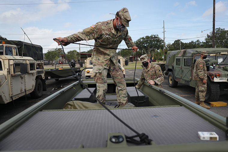 A member of the Louisiana National Guard prepares a boat for the arrival of Hurricane Laura on August 26, 2020 in Lake Charles, Louisiana.