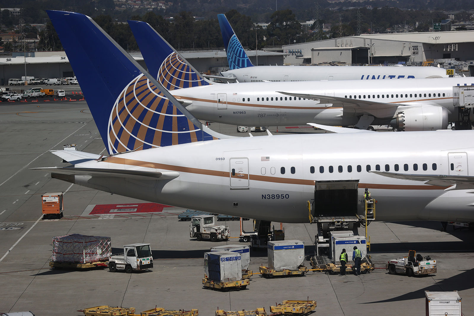 Workers load cargo onto a United Airlines plane at San Francisco International Airport on July 8.