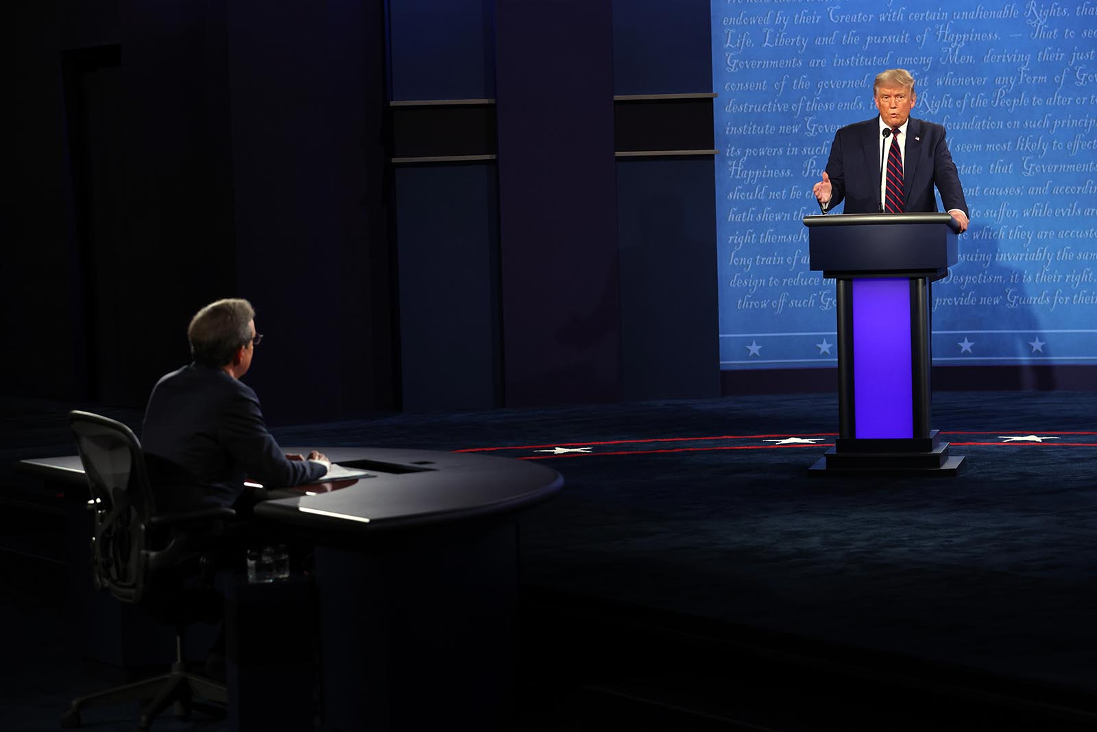 President Donald Trump participates in the first presidential debate against Democratic presidential nominee Joe Biden,moderated by Fox News anchor Chris Wallace at the Health Education Campus of Case Western Reserve University on September 29 in Cleveland, Ohio.