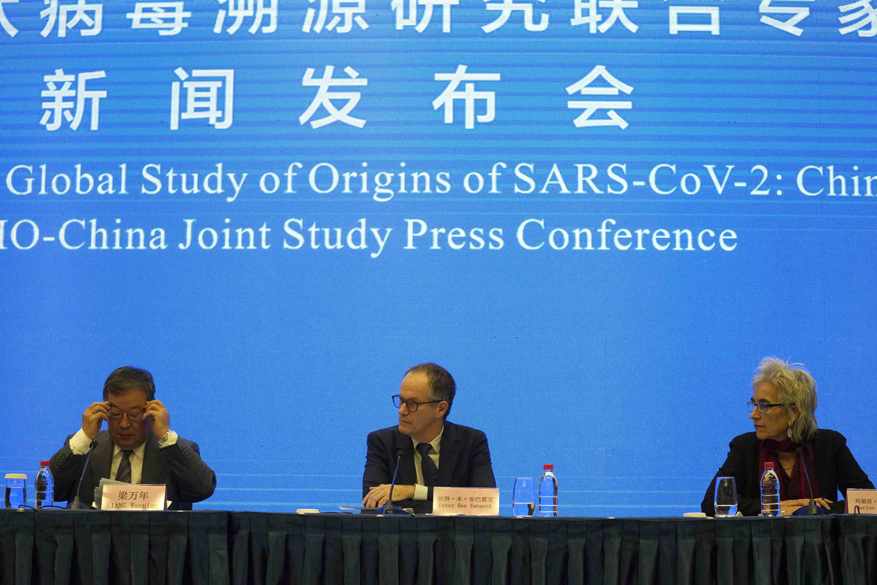 Chinese health official Liang Wannian, left, is seen during a press conference with World Health Organization representatives Peter Ben Embarek, center, and Marion Koopmans, in Wuhan, China, on February 9.