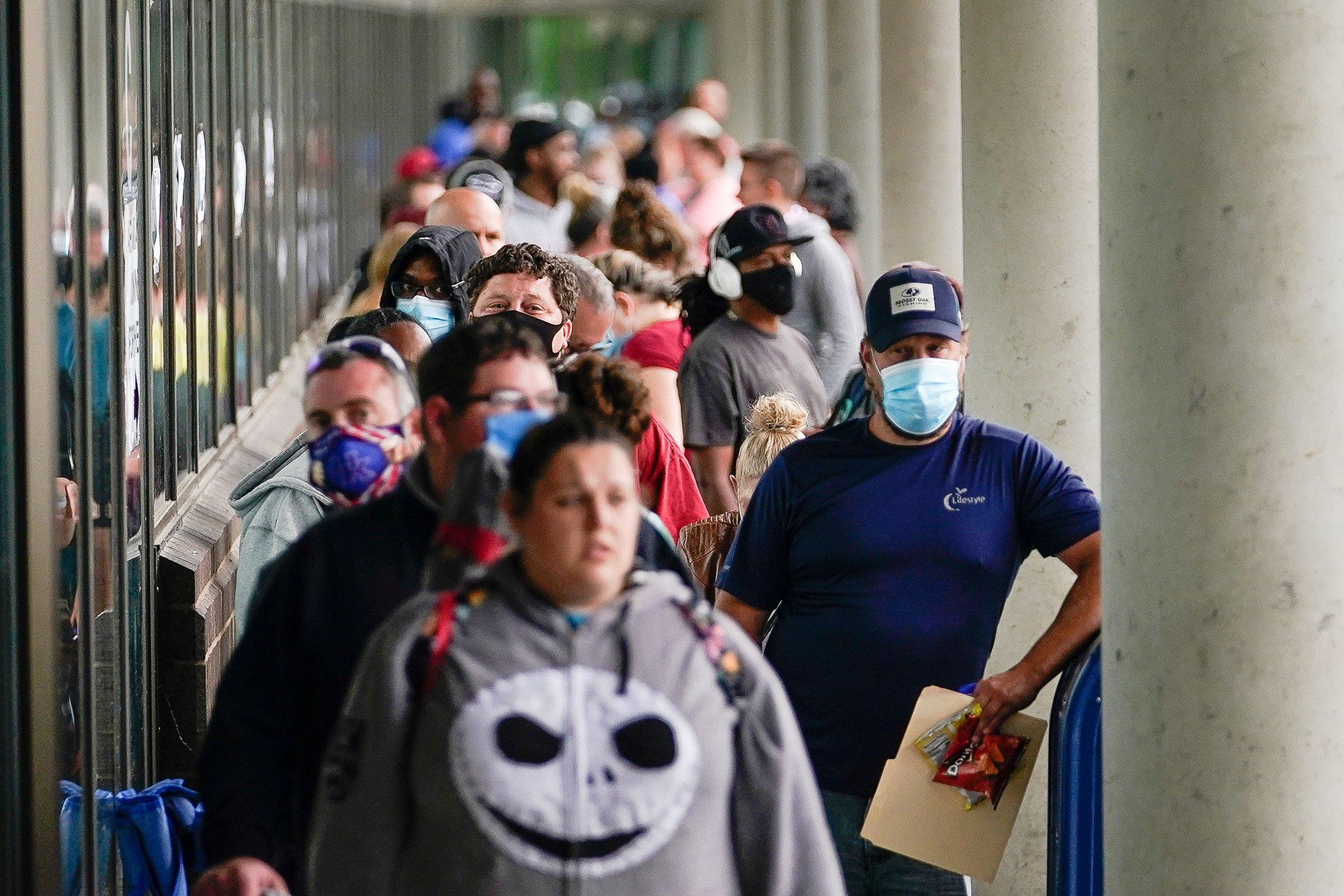 People line up outside a Kentucky Career Center hoping to find assistance with their unemployment claim in Frankfort, Kentucky, on June 18.