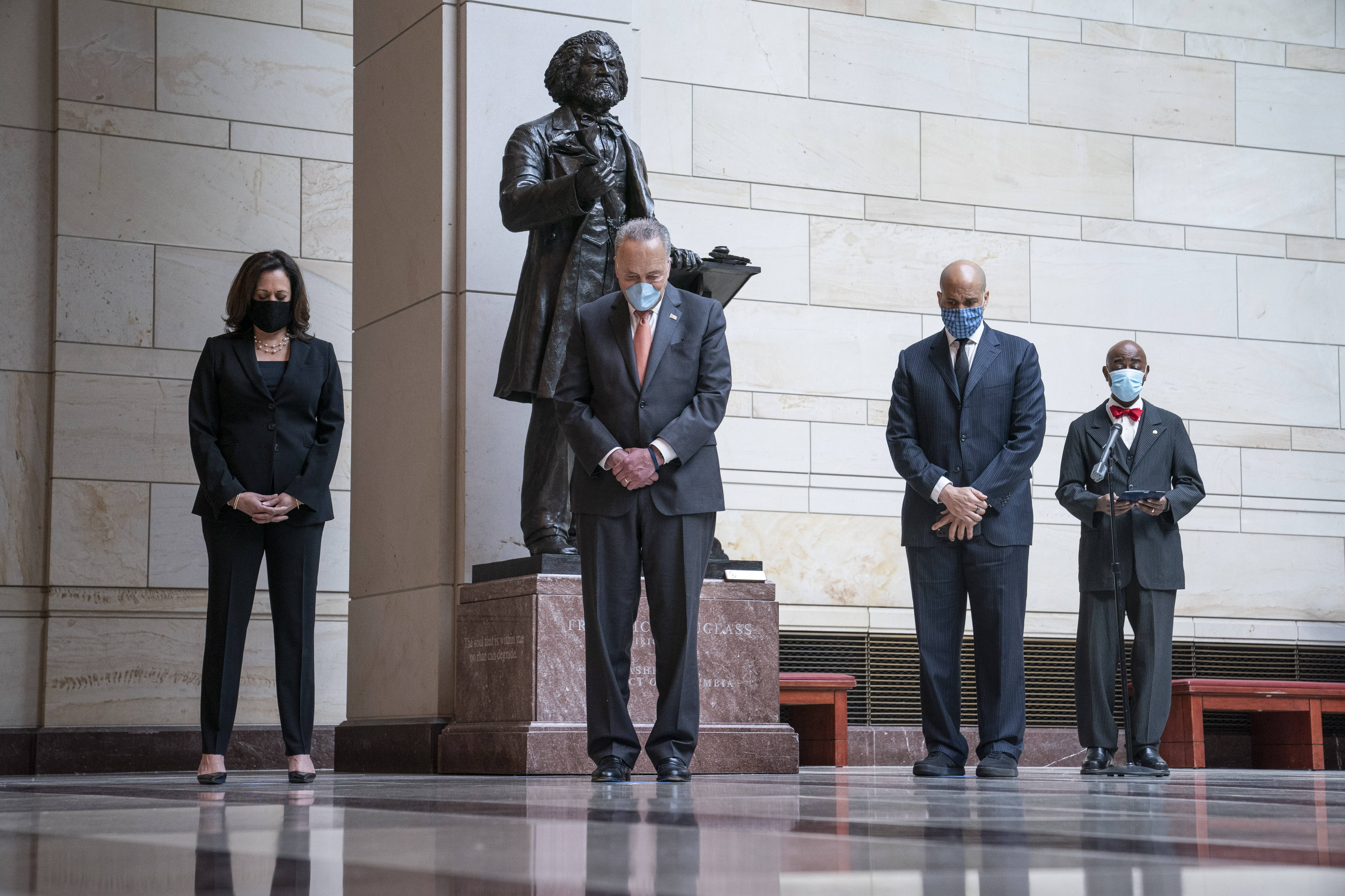 Senate Democrats, including, from left, Sen. Kamala Harris, Senate Minority Leader Chuck Schumer and Sen. Cory Booker, participate in a moment of silence at the US Capitol in Washington on June 4. The moment of silence was to honor deaths of George Floyd, Ahmaud Arbery and Breonna Taylor.