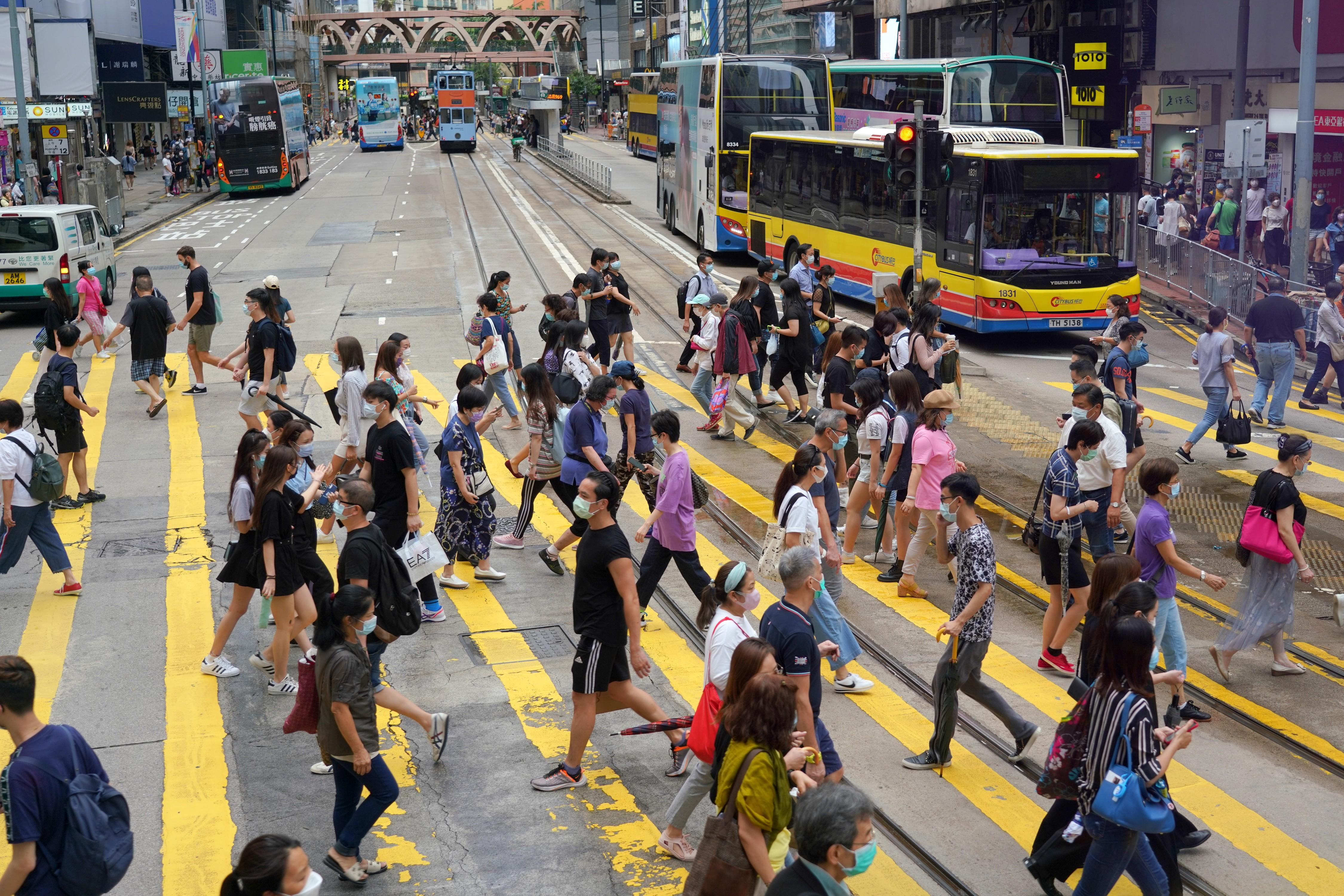 People walk in Hong Kong on September 8.