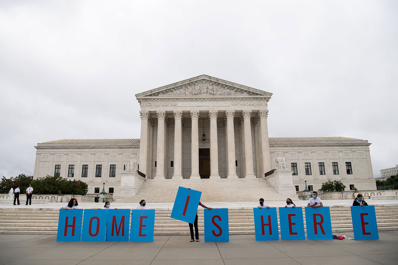 Activists hold a banner in front of the Supreme Court in Washington, DC, on June 18. In a 5-4 ruling Thursday, the Supreme Court blocked the Trump administration's attempt to end DACA.