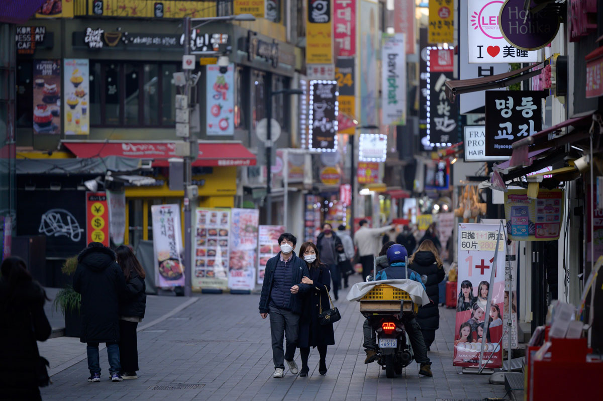 Shoppers walk along a street in the Myeongdong district of Seoul, South Korea on December 28.