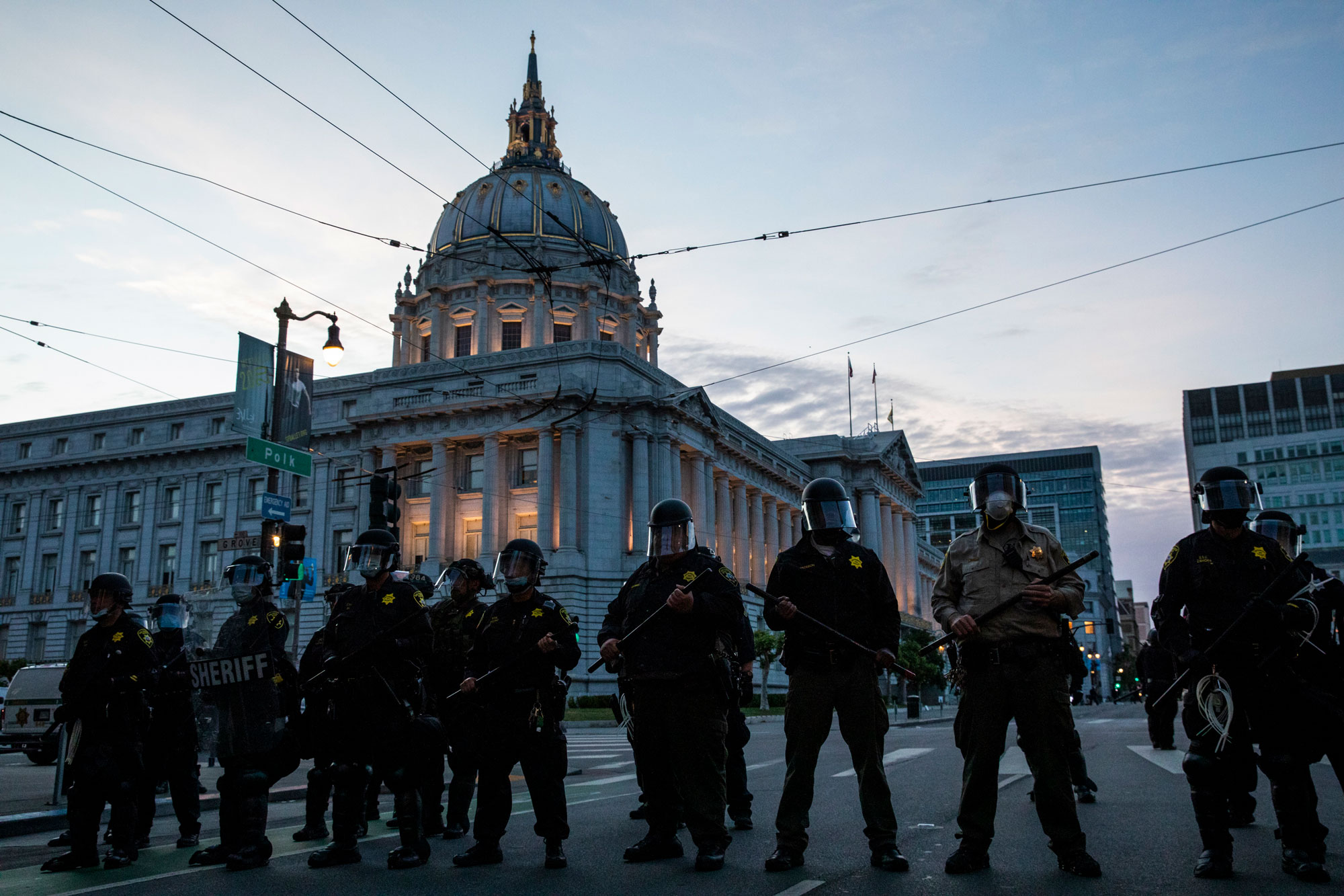 Police officers stand guard in front of San Francisco's City Hall on Sunday, May 31.