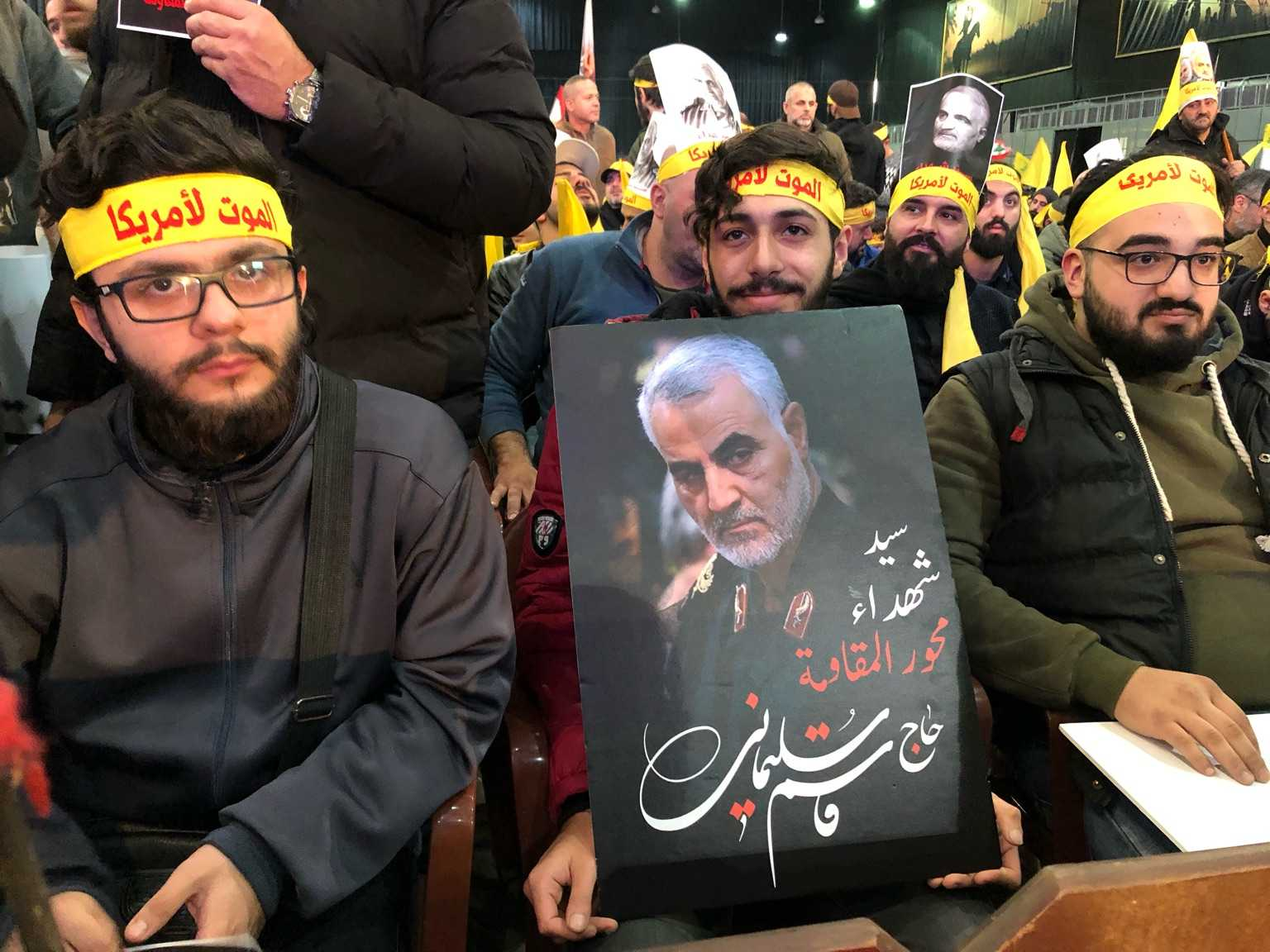 "Photo taken from a memorial ceremony in Dahiyeh, the southern suburb of Beirut. The yellow headbands read, ""death to America."""