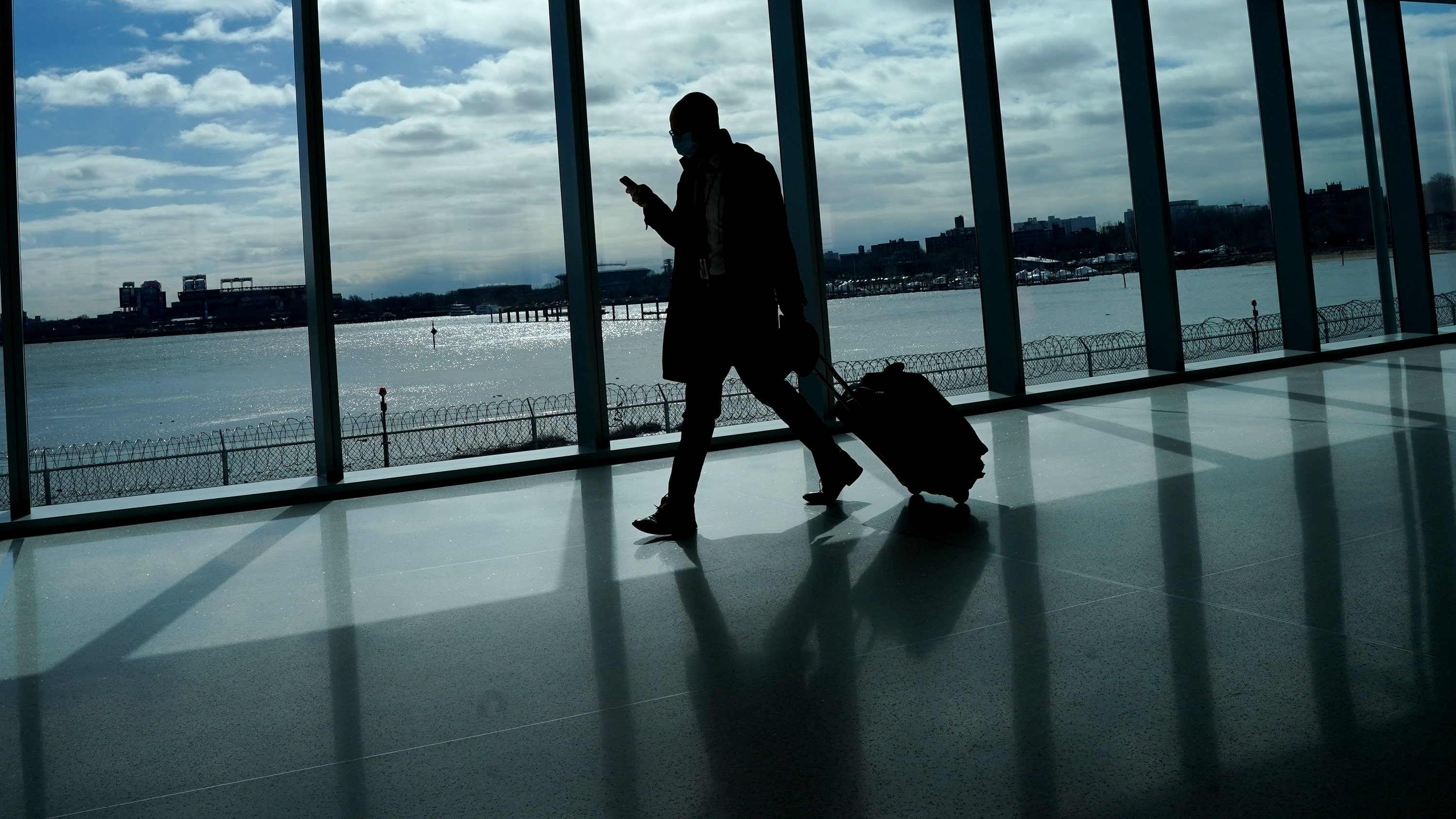 A person walks through LaGuardia Airport in New York, on March 6.