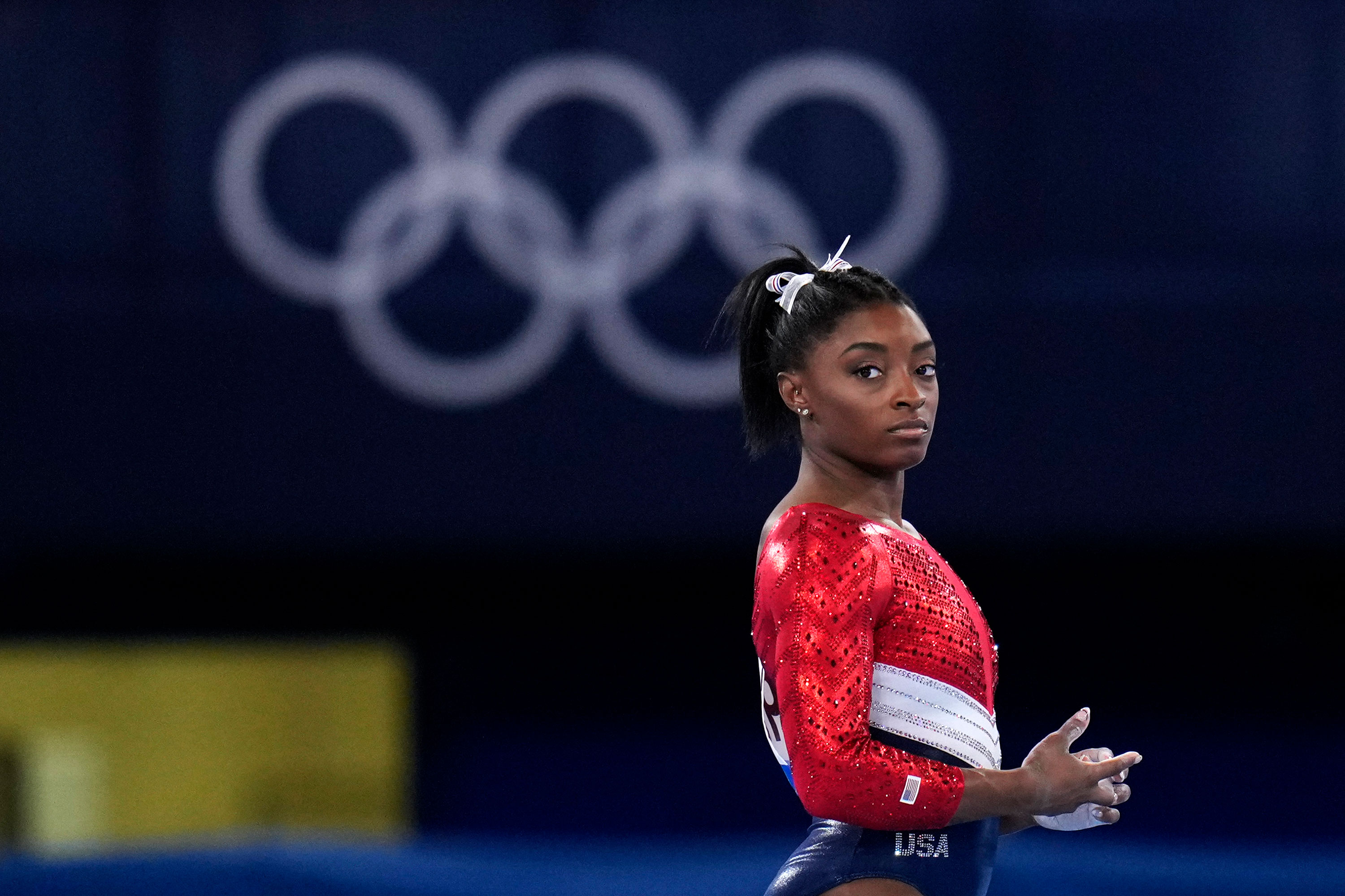Simone Biles waits to perform on the vault during the artistic gymnastics final on July 27.