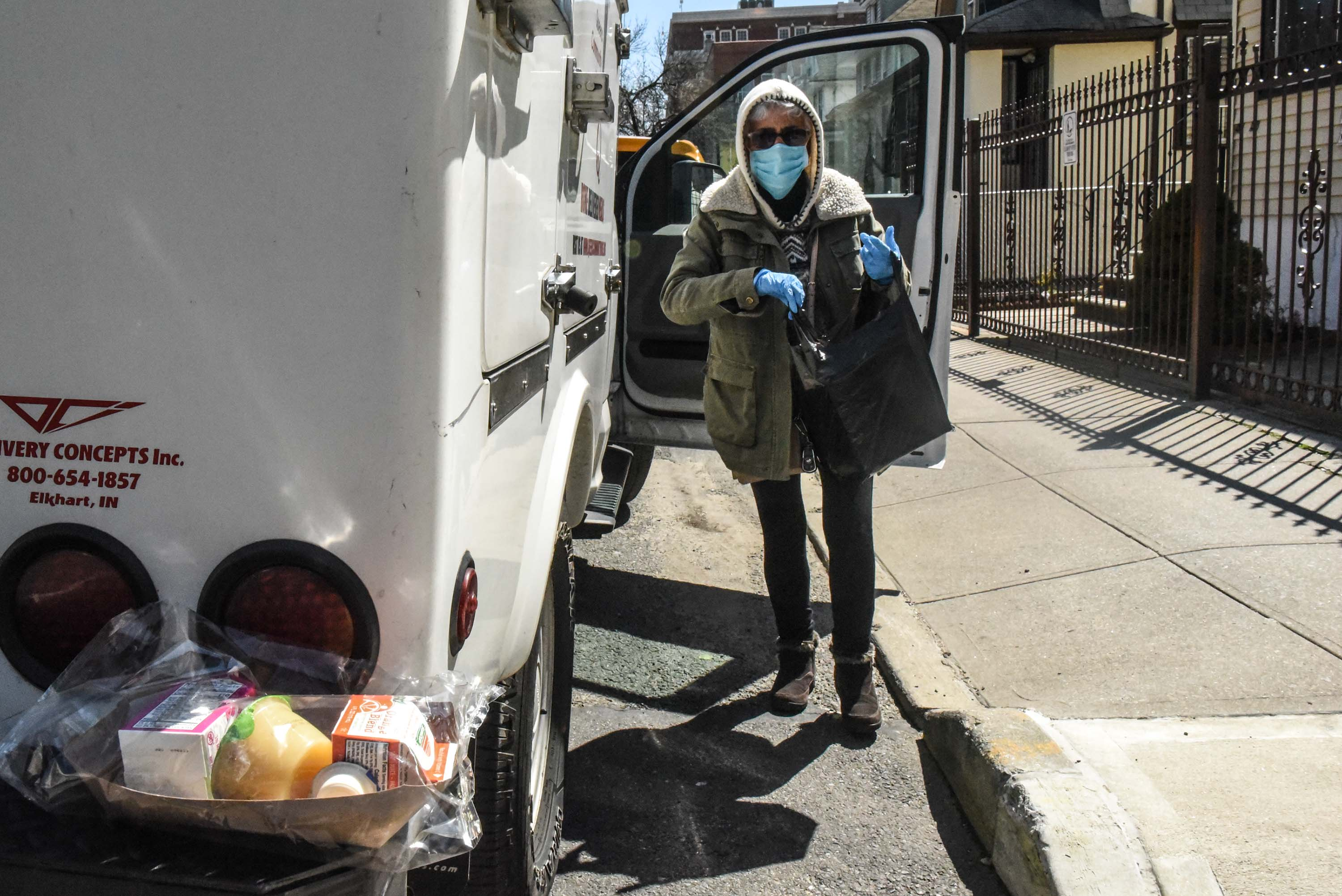 A person from Queens Community House delivers a meal to an elderly client in the Elmhurst neighborhood of New York City, on April 1.