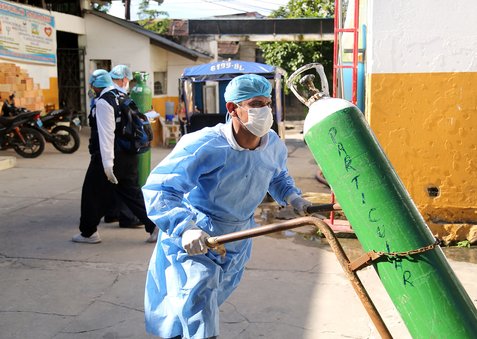 A health worker transports an oxygen tank at the Cesar Garayar support hospital in the city of Iquitos, Peru, on May 22.