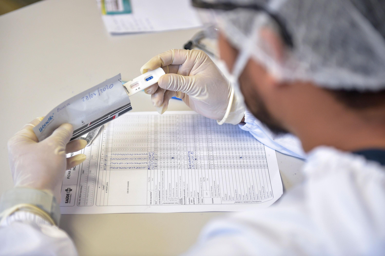A nurse observes a rapid coronavirus test on July 28 in Ilha de Marajo, Brazil.