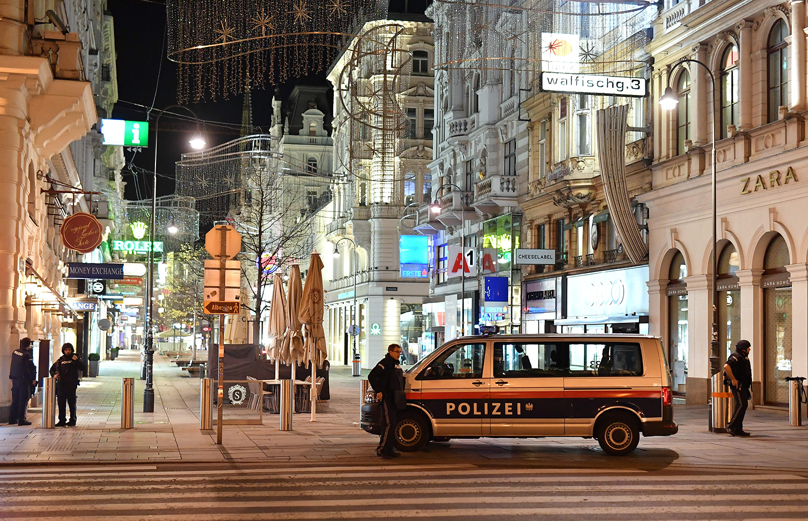 Armed policemen stand guard in a shopping street in the center of Vienna on November 2.