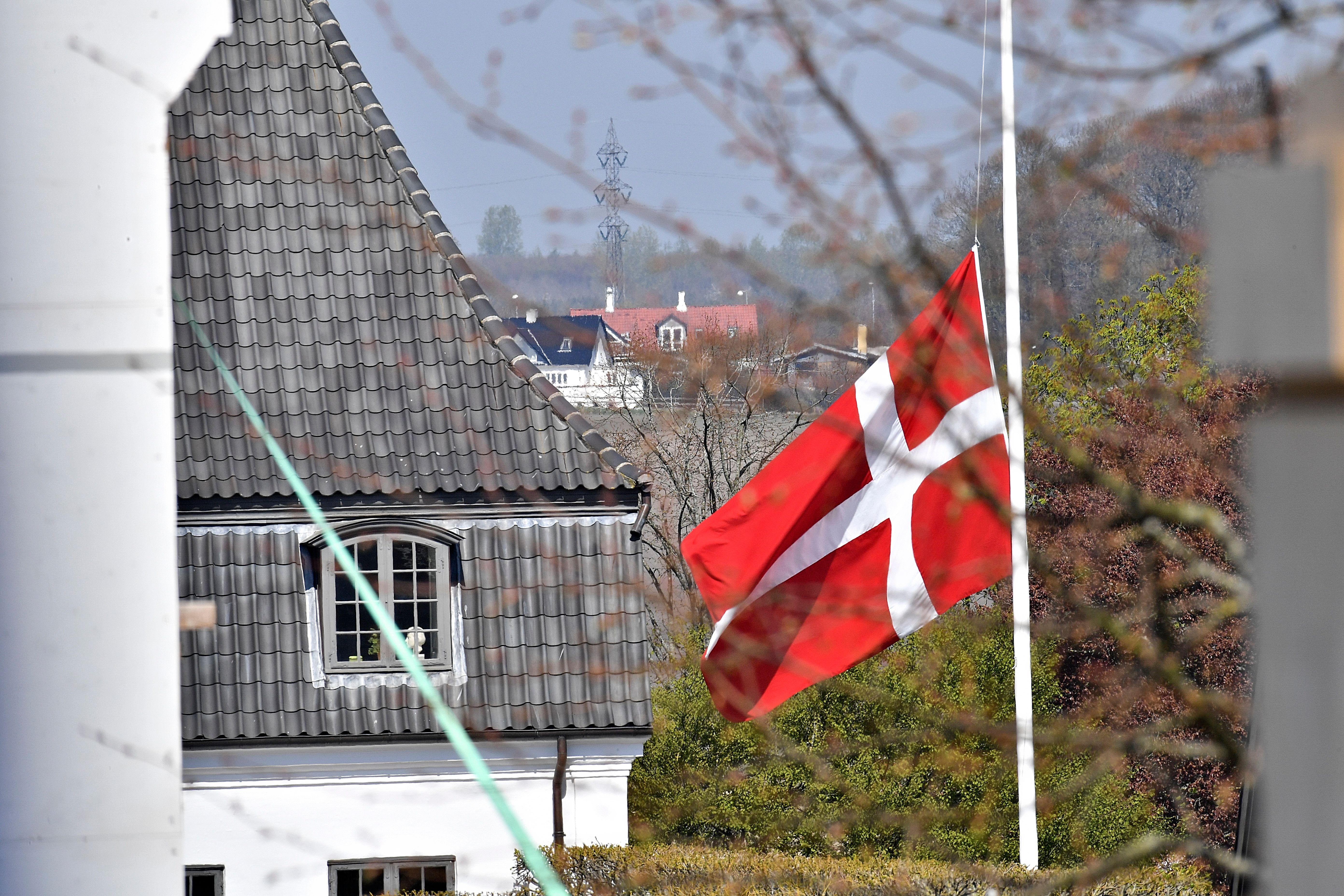 The Danish flag is at half mast at Hojvangskolen in Aarhus, Denmark, the school attended by the children of Danish billionaire and owner of fashion business Bestseller Anders Holch Povelsen.