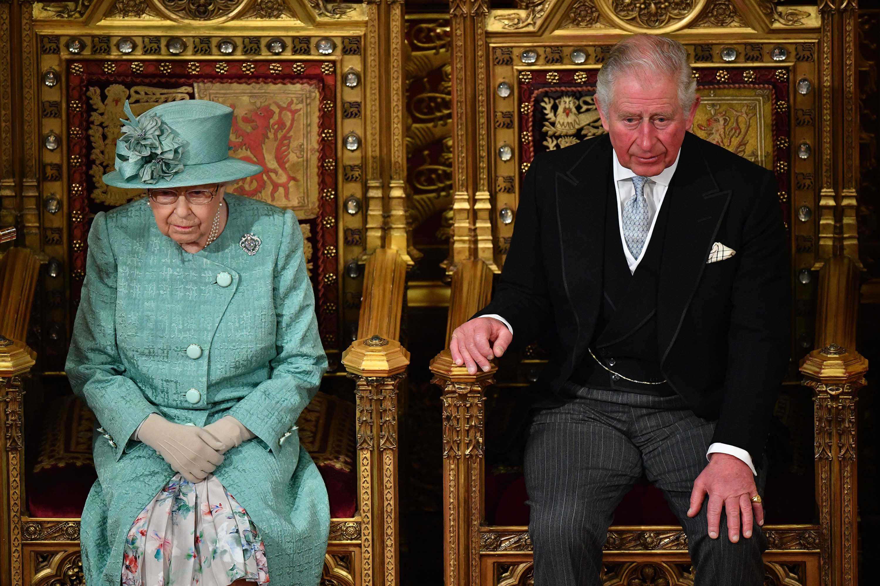 Britain's Queen Elizabeth II and Prince Charles are pictured during the State Opening of Parliament in December 2019.