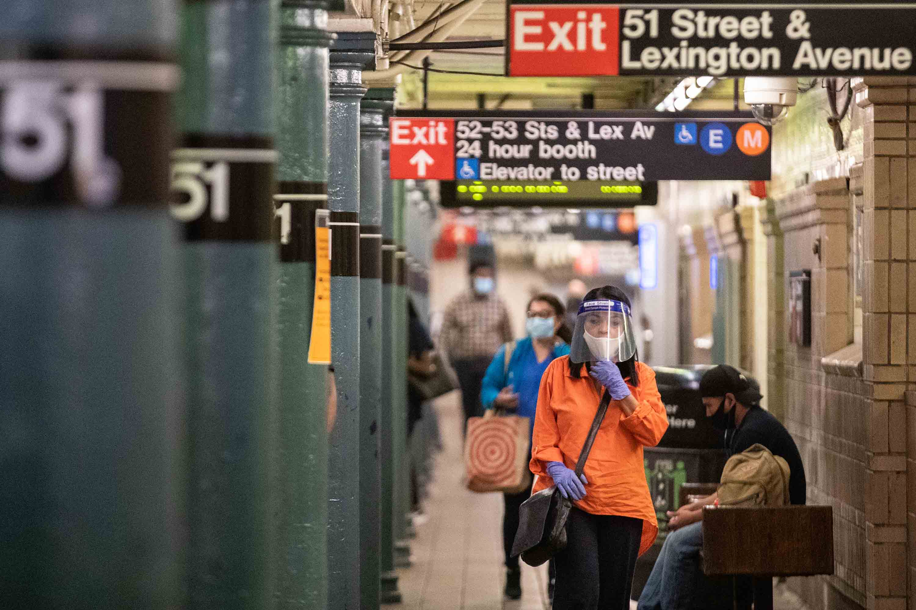 Commuters wearing protective masks on a New York subway station platform on June 22.