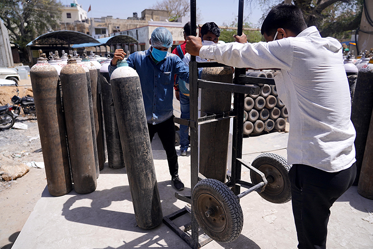 Workers sort oxygen cylinders used for Covid-19 coronavirus patients at a facility in Jawaharlal Nehru Hospital in Ajmer on April 22.