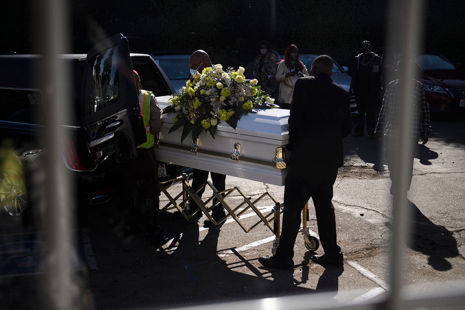 A casket is loaded into a hearse at the Boyd Funeral Home, as burials at cemeteries are delayed to the surge of Covid-19 deaths on January 14, in Los Angeles, California.