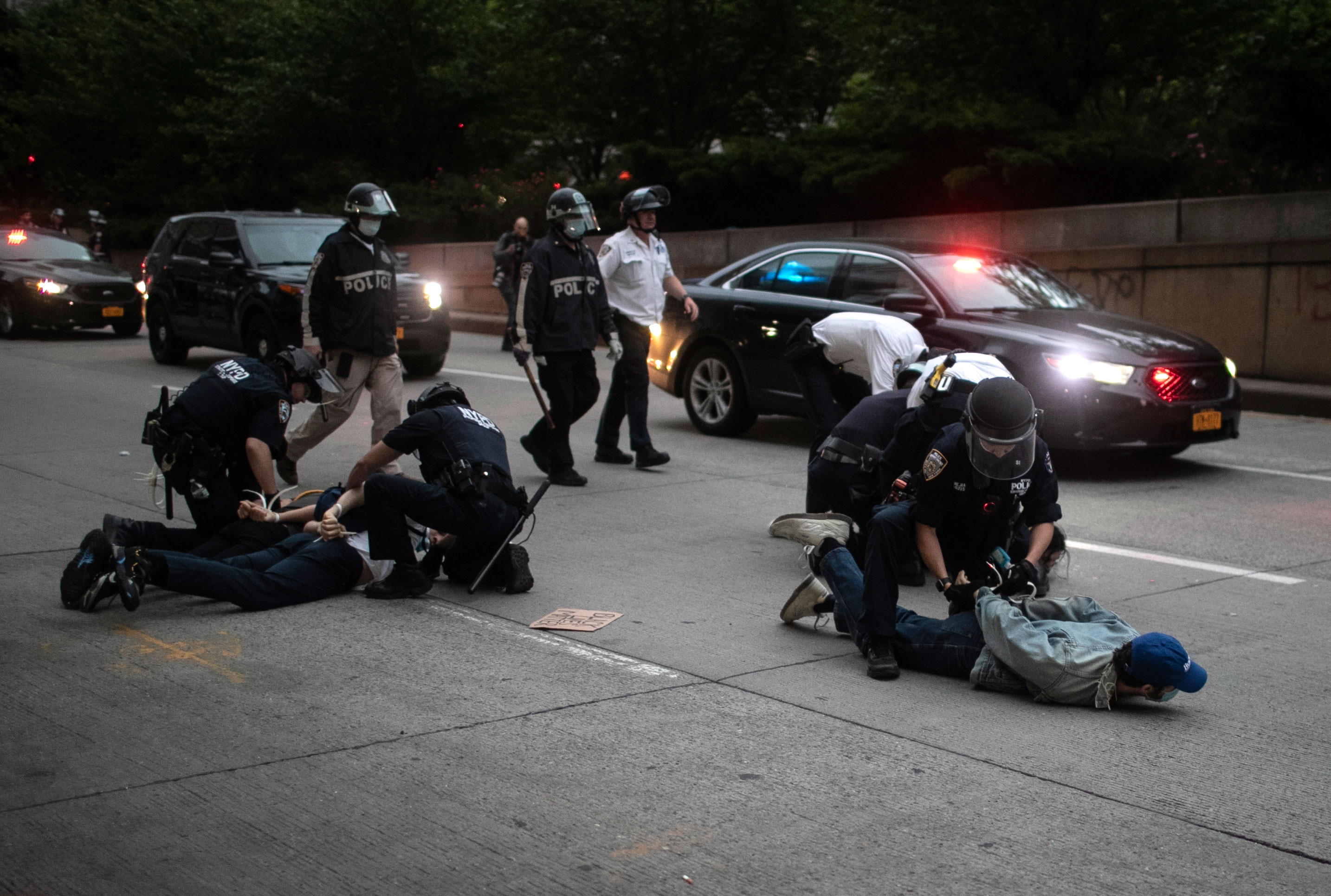 Police arrest protesters after curfew on June 2, in New York.