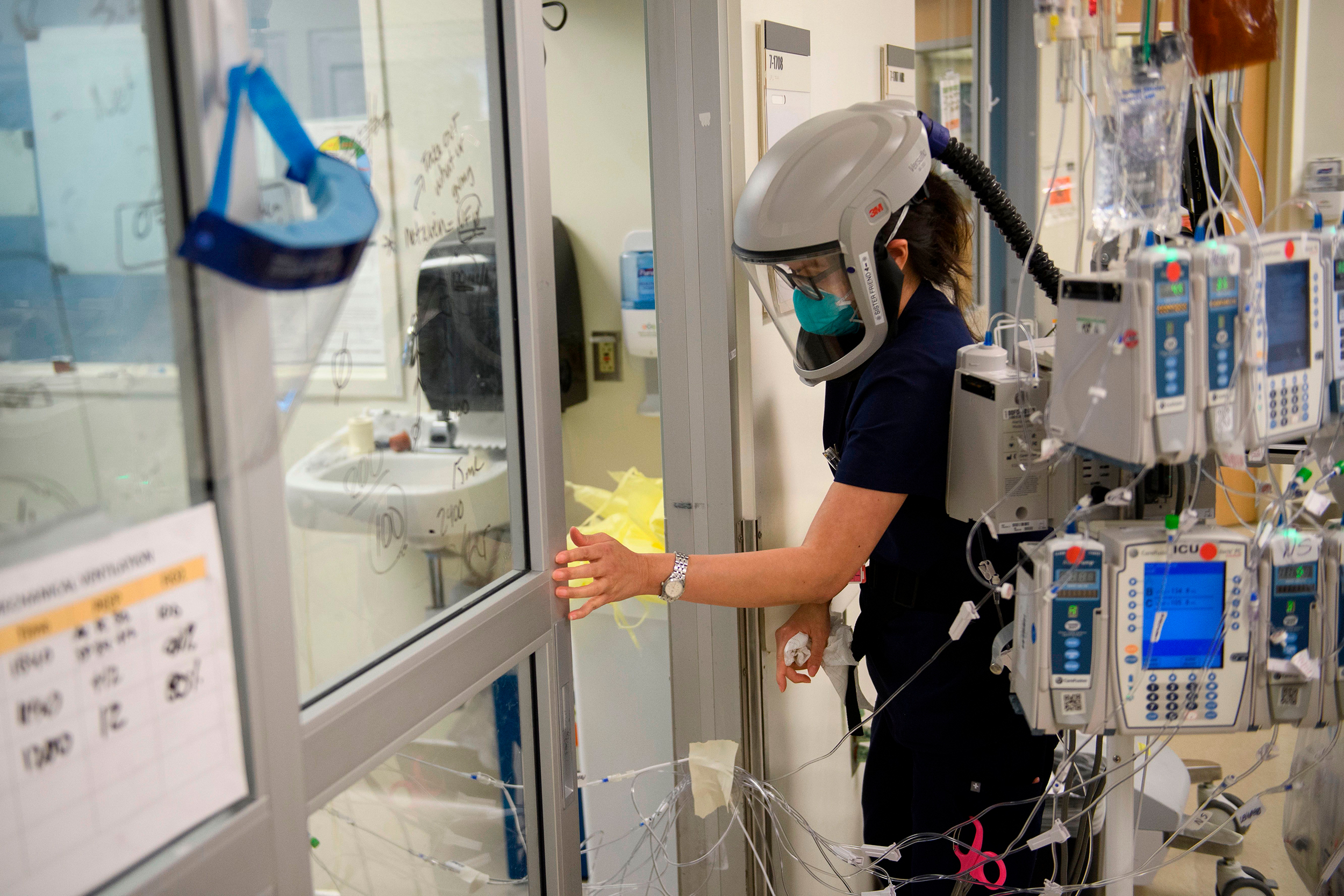 A nurse closes the door to a patient's room in a Covid-19 intensive care unit at Martin Luther King Jr. Community Hospital on January 6 in Los Angeles, California.