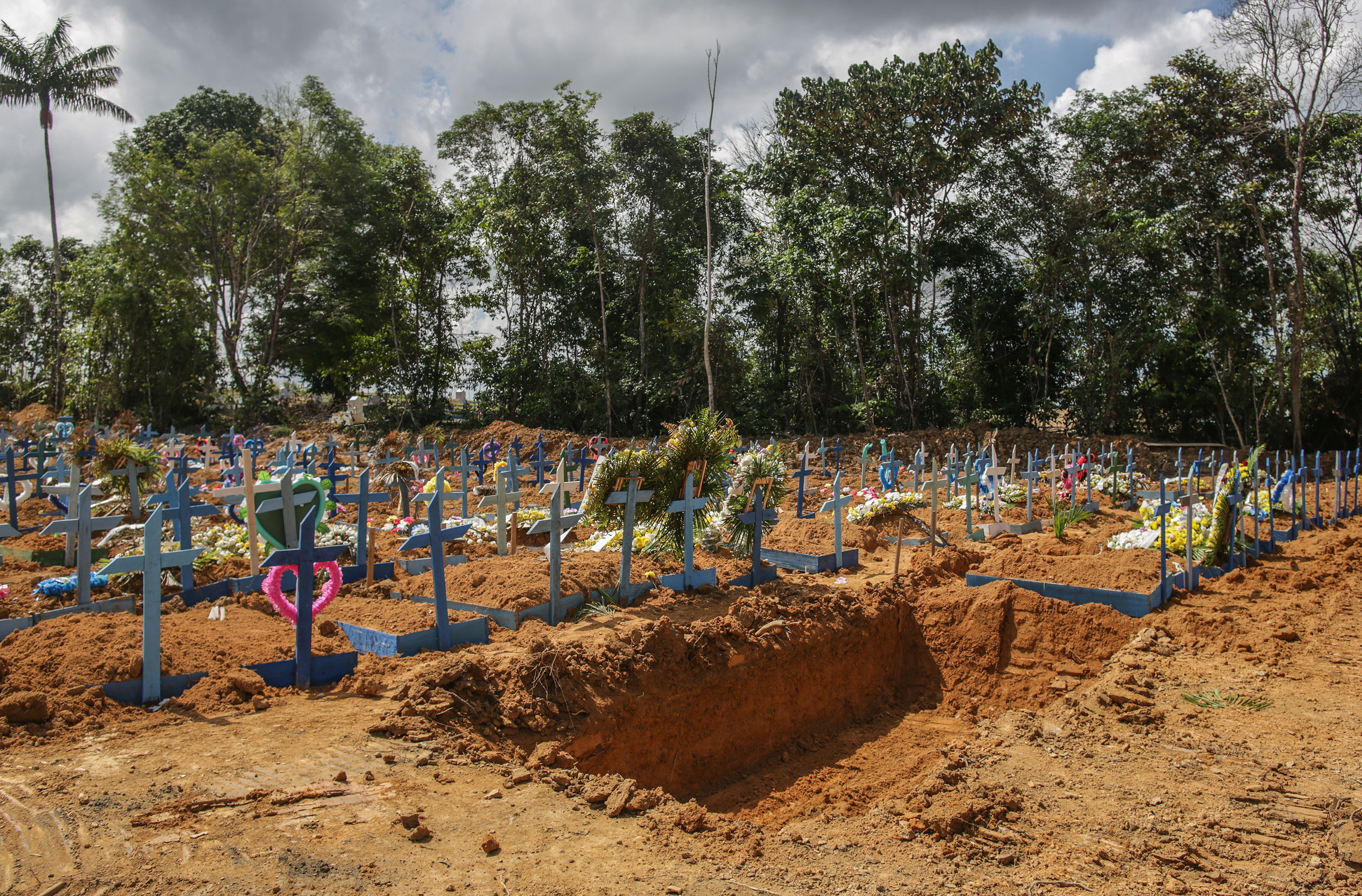 An open mass grave is seen at the Parque Tarumã cemetery on May 27 in Manaus, Brazil.