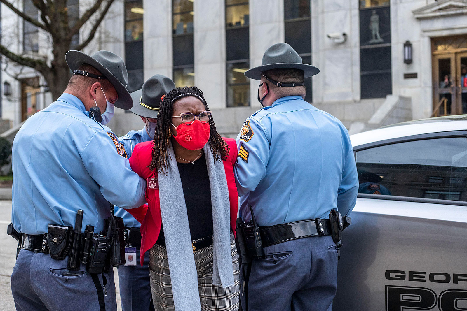 Georgia State Representative Park Cannon is placed into the back of a patrol car by Georgia state troopers after being arrested at the Georgia Capitol in Atlanta, on Thursday.