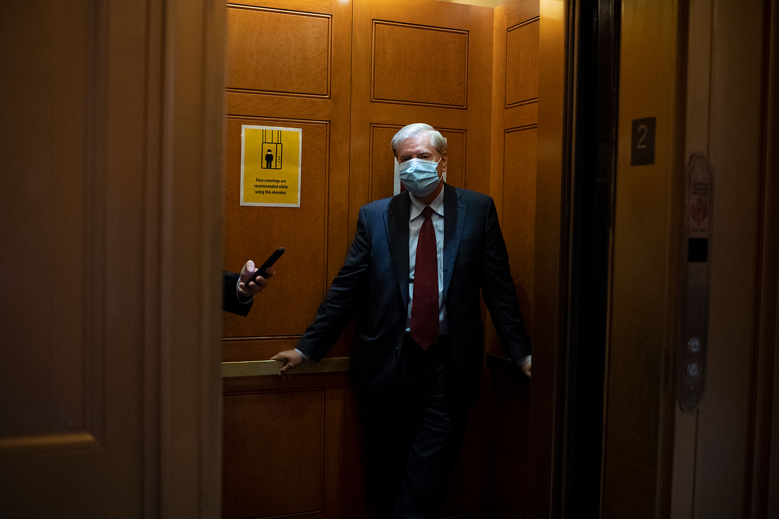 Sen. Linsey Graham departs from the Senate Floor after a vote on Wednesday, September 16.