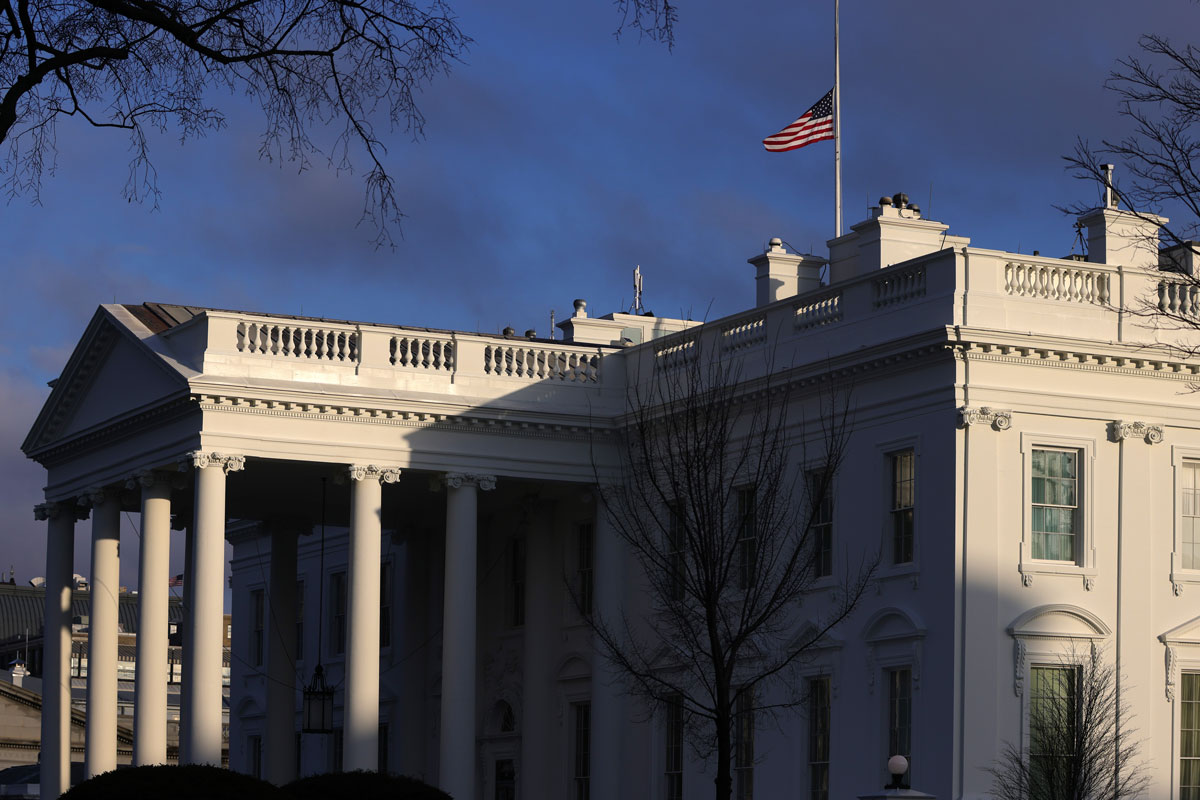 The U.S. flag is flied at half-staff on the roof of the White House to honor lives that have been lost to Covid-19 February 22 in Washington, DC.