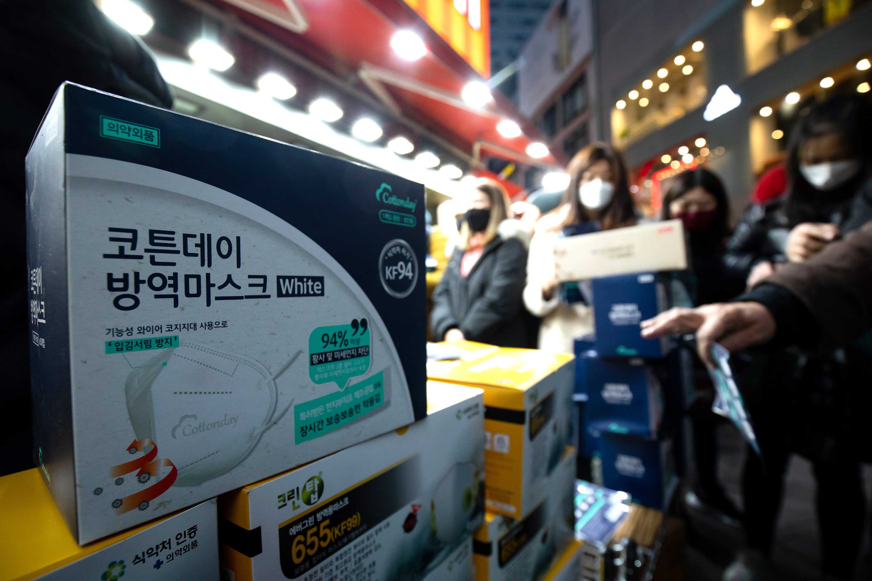 Boxes of protective masks are displayed for sale outside a supermarket in Seoul, South Korea, on Monday.