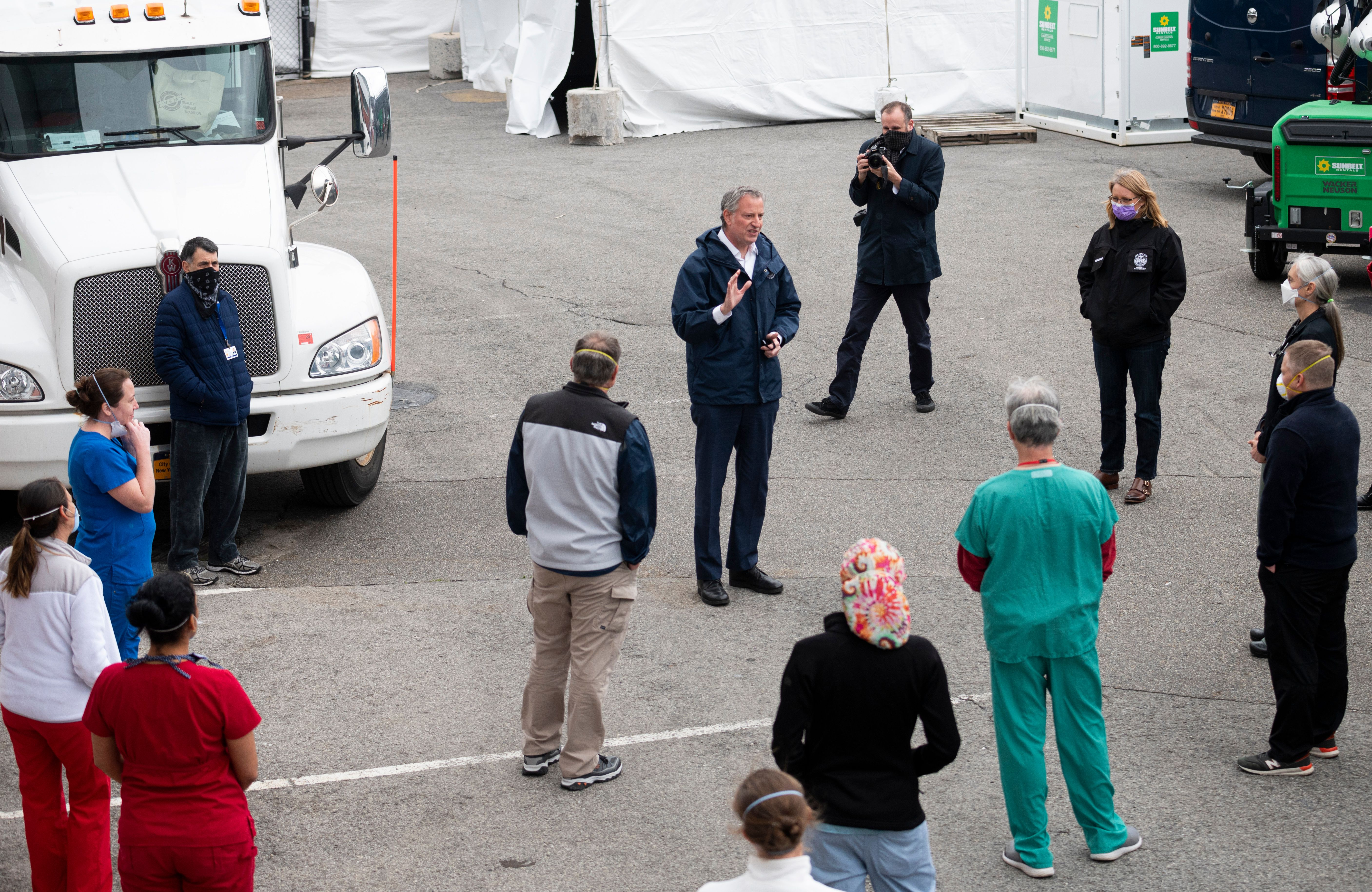 New York City Mayor Bill de Blasio, center, speaks during a press conference at a temporary hospital located at the USTA Billie Jean King National Tennis Center in New York City on April 10.