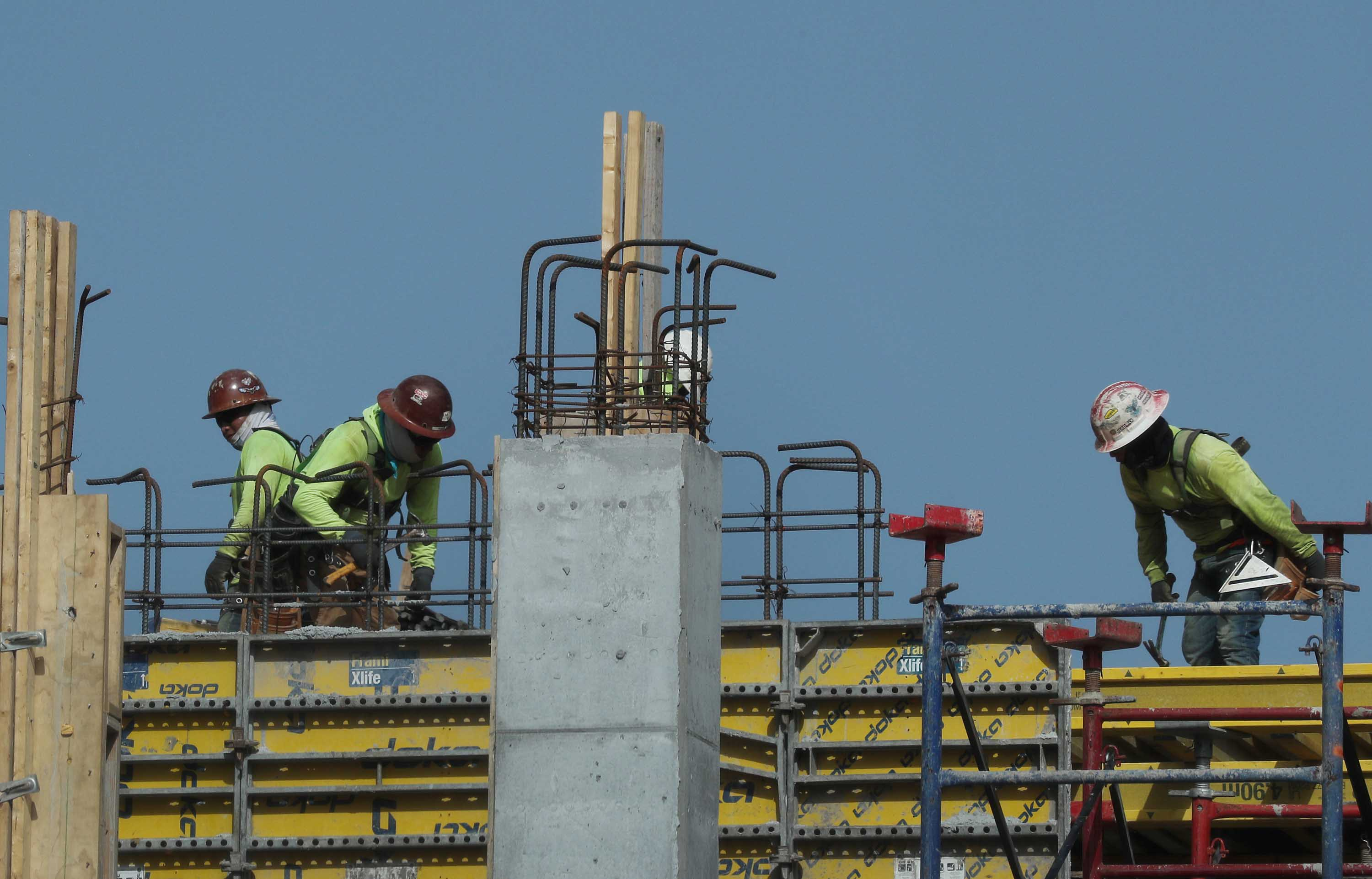 Construction workers are seen on a job site in Miami, Florida on September 4.