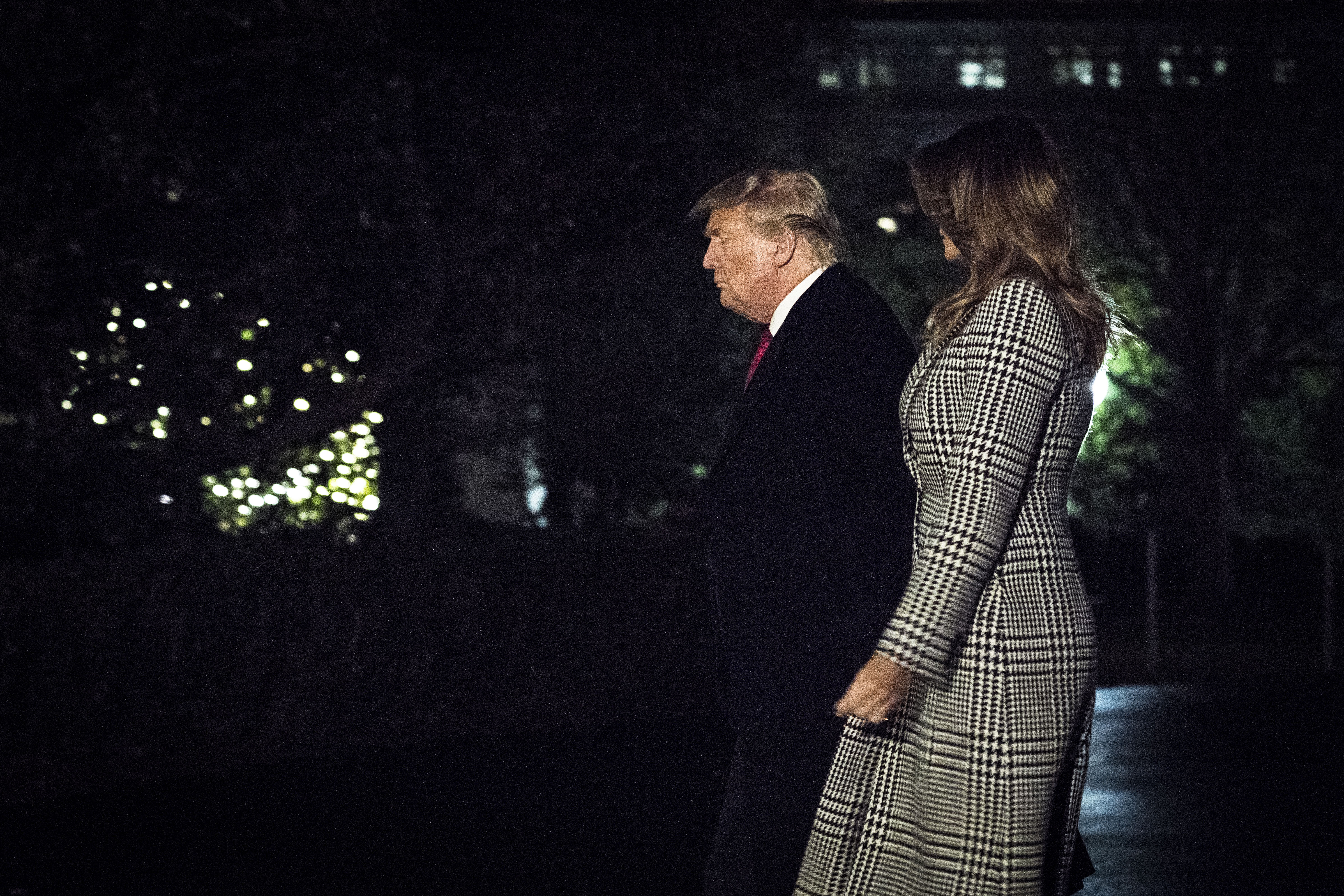 US President Donald Trump and first lady Melania Trump arrive to the White House on December 4, 2019.