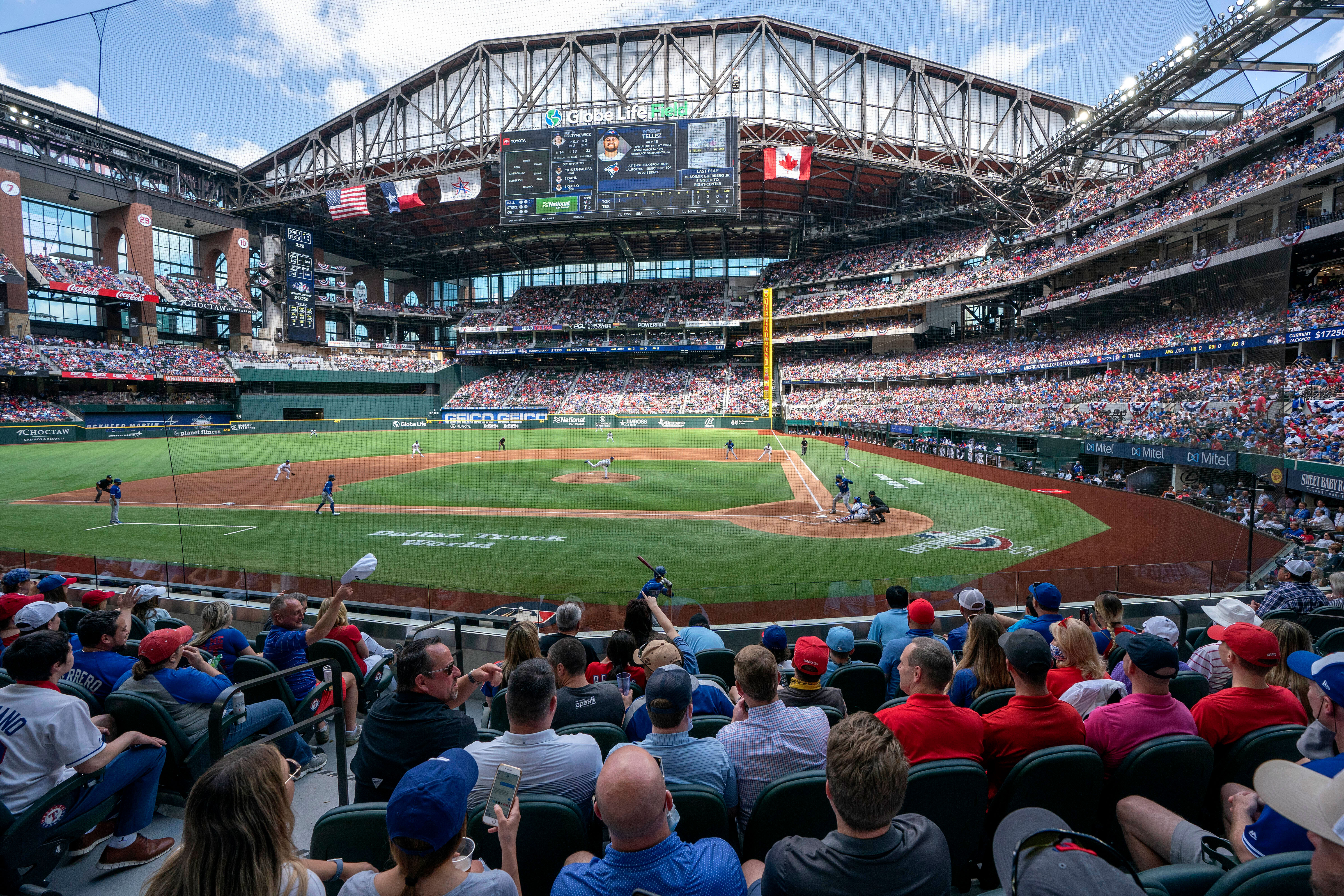People fill the stands at Globe Life Field in Arlington, Texas, during a baseball game between the Texas Rangers and the Toronto Blue Jays on April 5.
