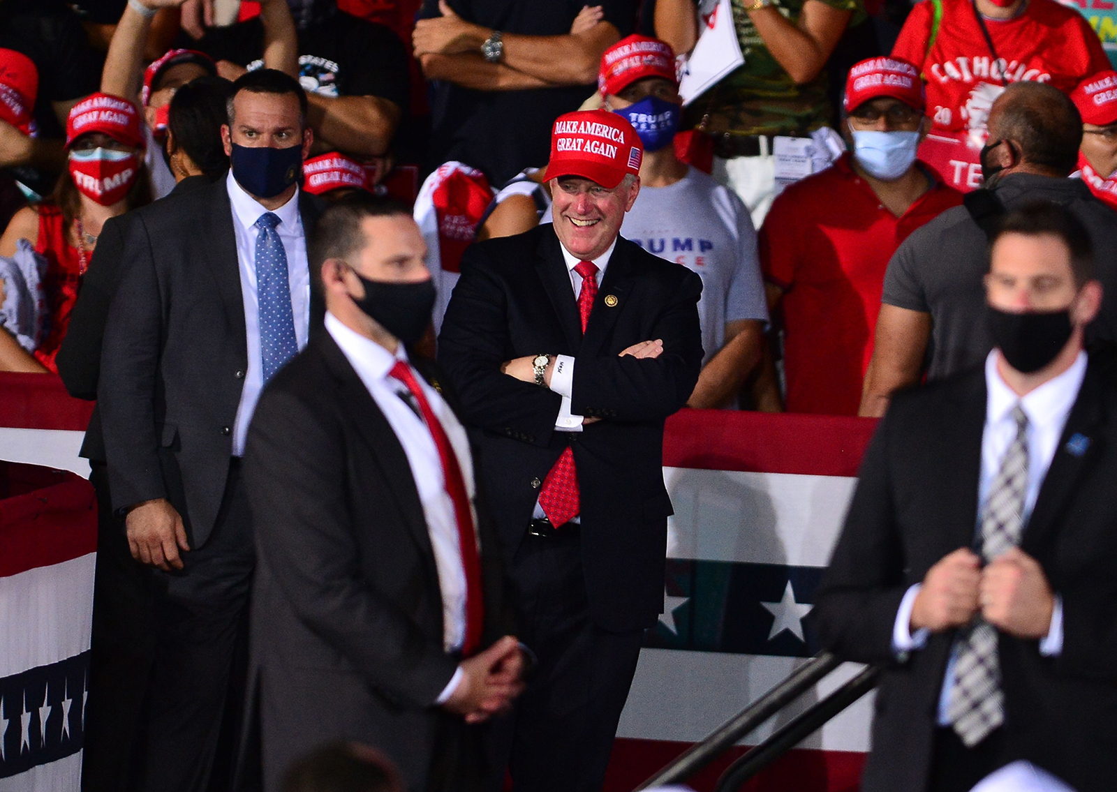 White House Chief of Staff Mark Meadows (center) listens as US President Donald Trump speak during his campaign event at Miami-Opa Locka Executive Airport in Florida, on November 1.