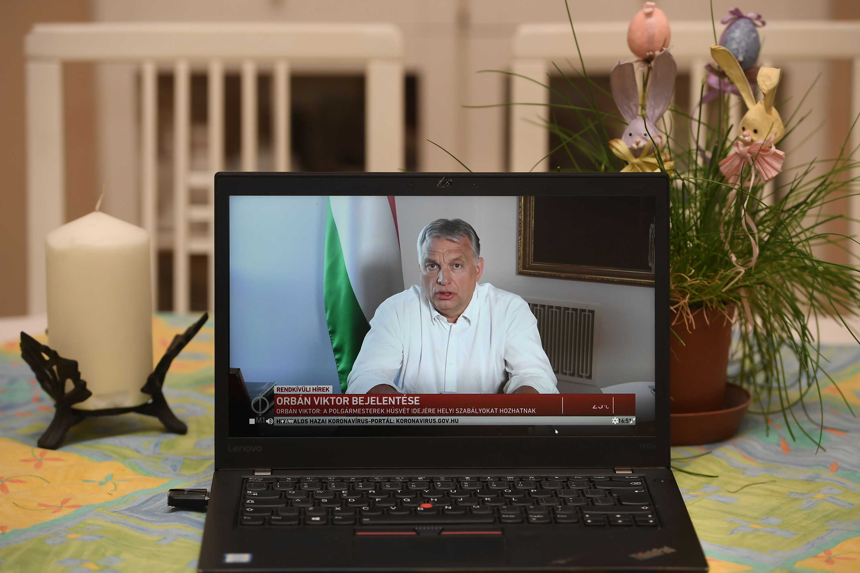 Hungarian Prime Minister Viktor Orban is pictured on a laptop in a flat in Budapest, as he makes an announcement on April 9.