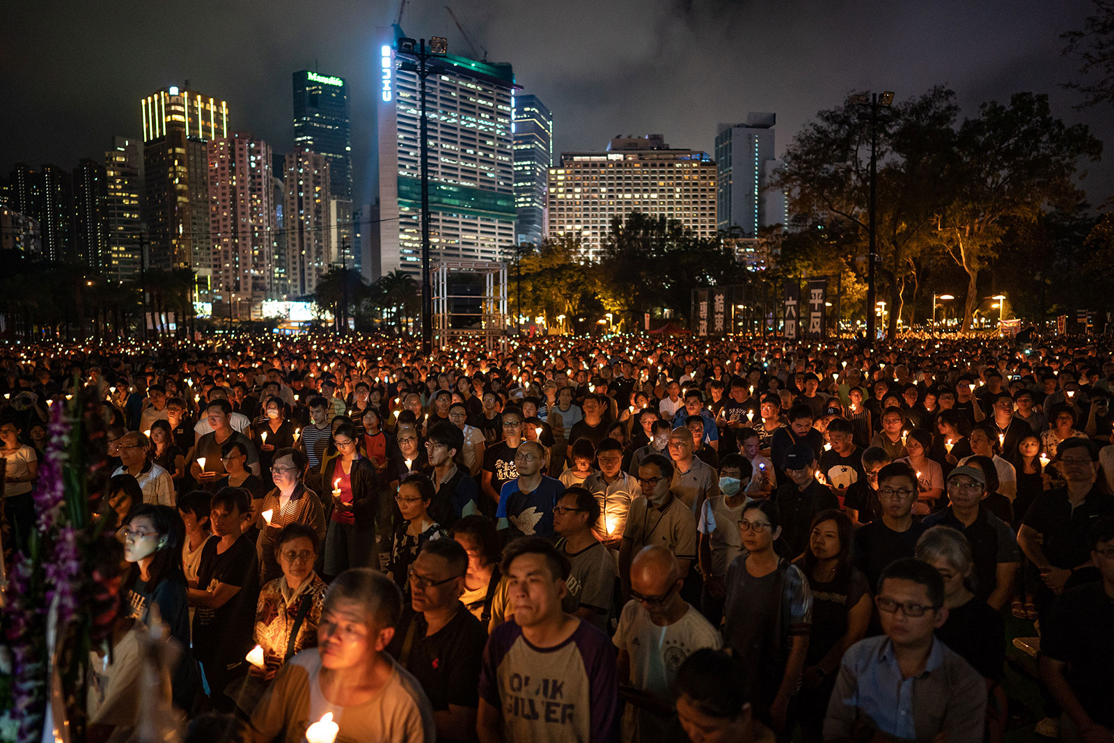 People gather during the annual Tiananmen Square vigil at Hong Kong's Victoria Park in 2019.