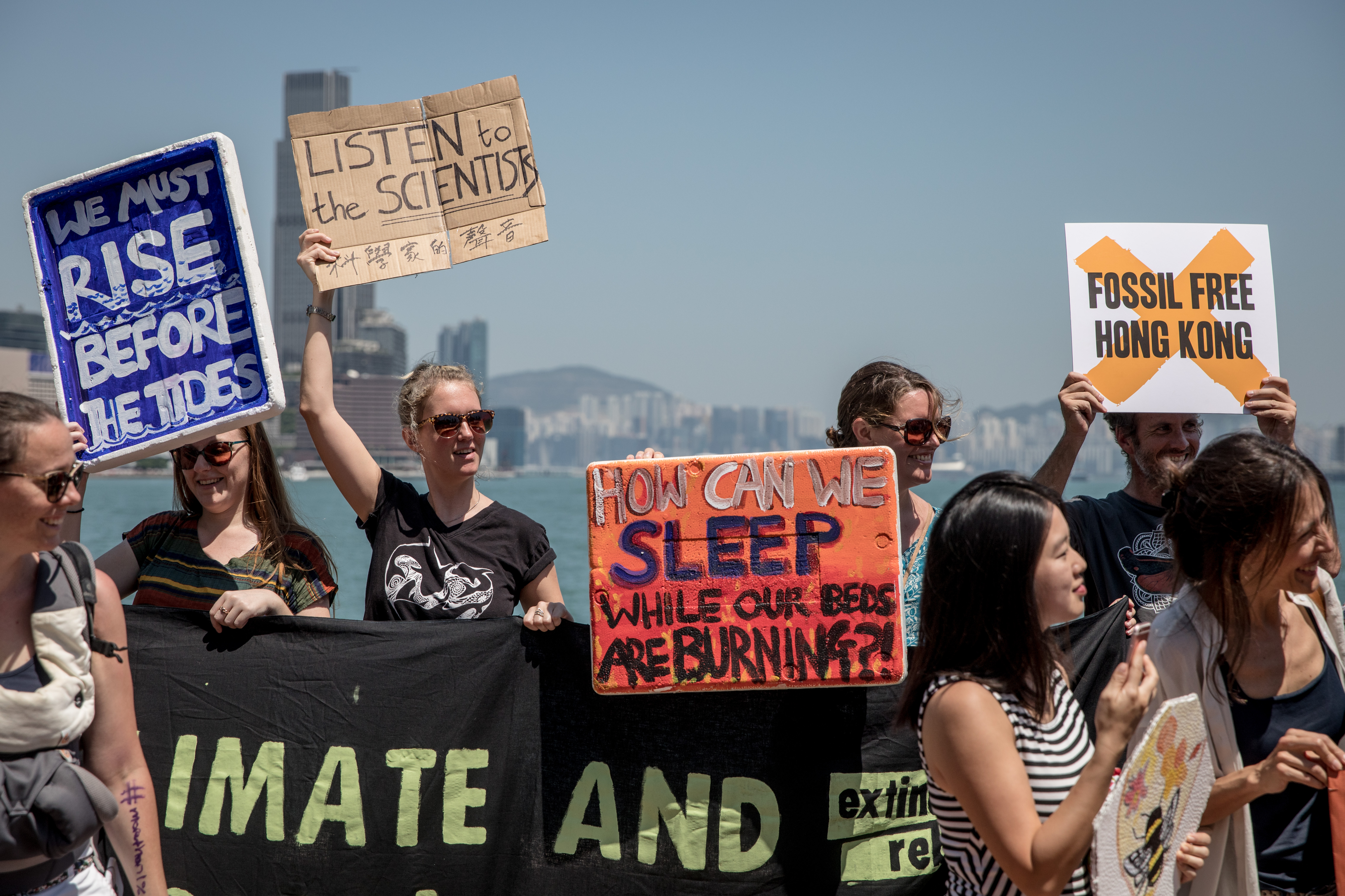 Protesters hold signs and chant slogans during the Hong Kong Climate Strike rally.