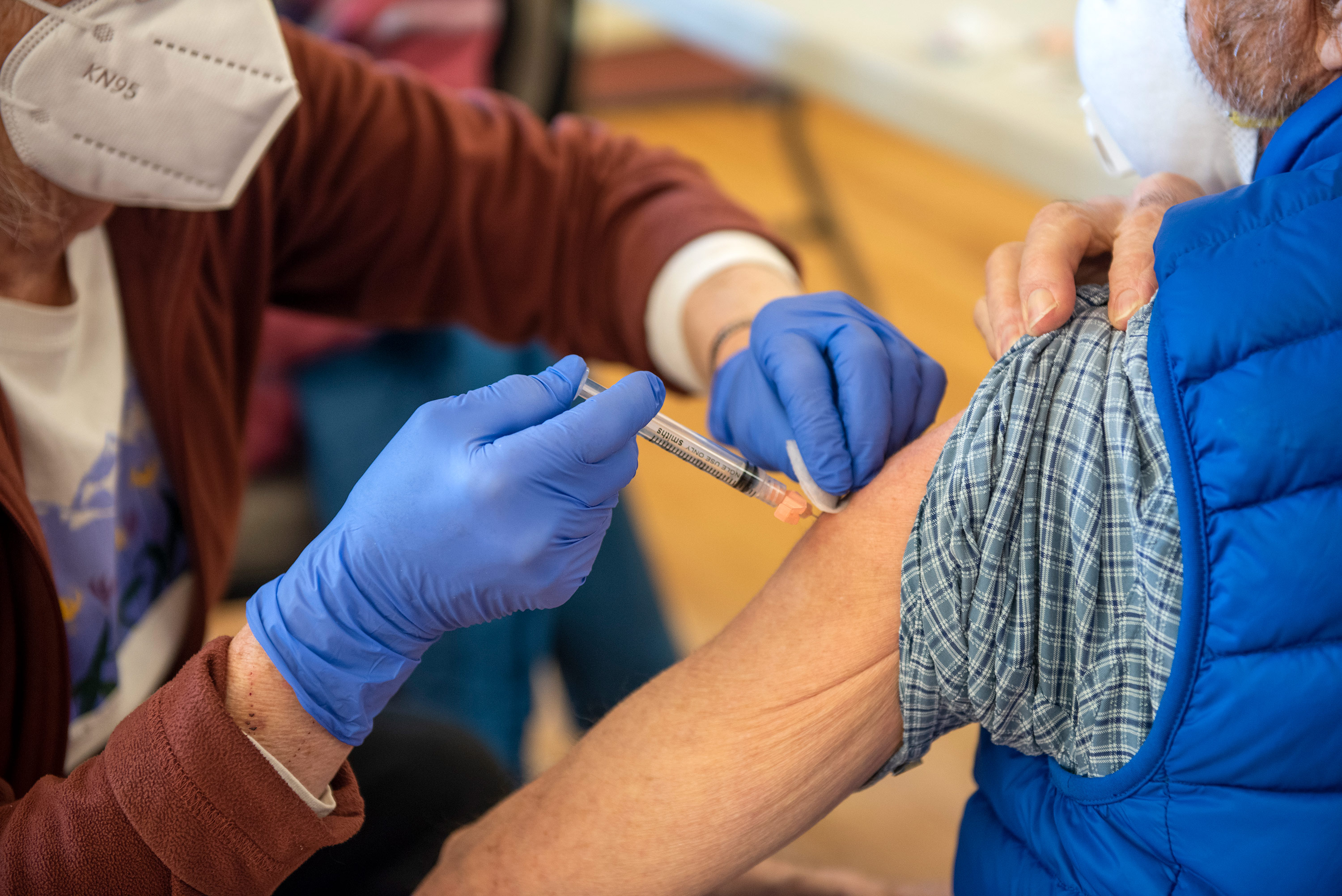 A nurse administers a Covid-19 vaccine to a patient at the Park County Health Department on January 28, in Livingston, Montana.
