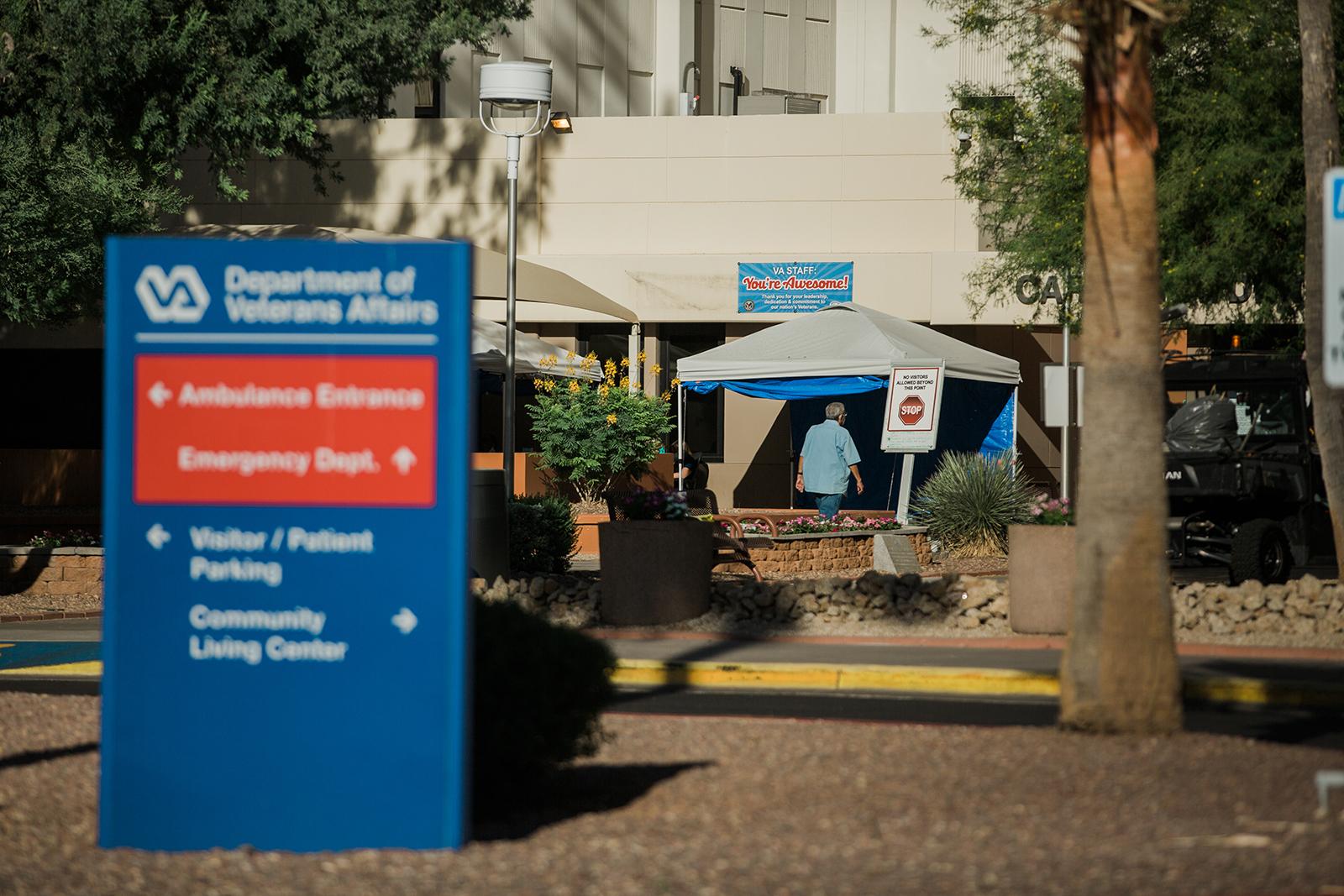 A person walks into the Carl T. Hayden VA Medical Center in Phoenix on June 17.