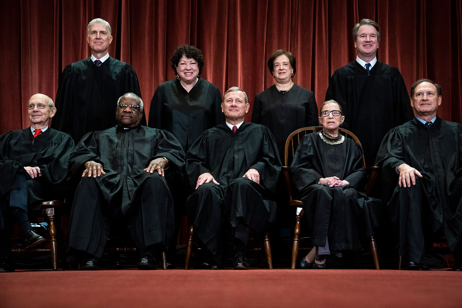 Justices of the US Supreme Court sit for their official group photo in 2018. From left, Justice Stephen G. Breyer, Justice Neil M. Gorsuch, Justice Clarence Thomas, Justice Sonia Sotomayor, Chief Justice John G. Roberts, Jr., Justice Elena Kagan, Justice Ruth Bader Ginsburg, Justice Brett M. Kavanaugh and Justice Samuel A. Alito.