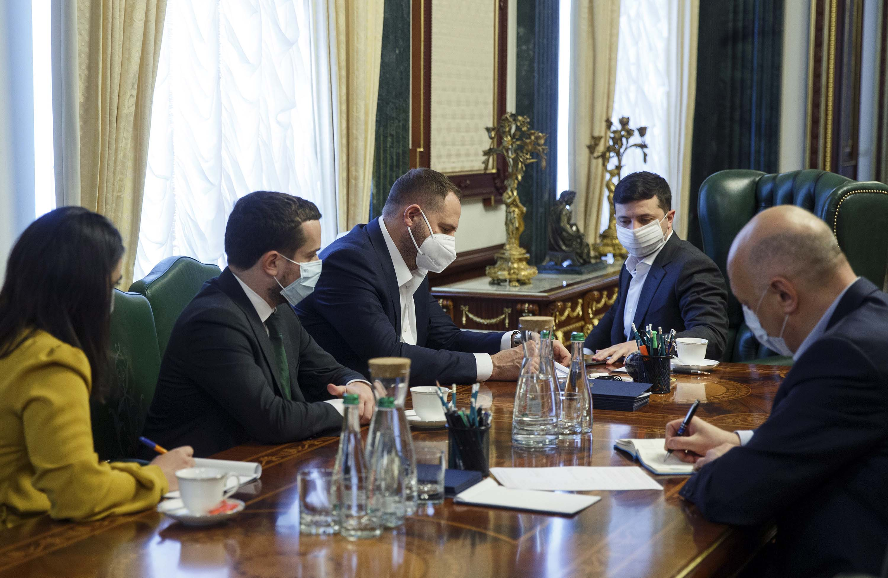 Ukrainian President Volodymyr Zelensky, second from right, is pictured during a meeting with officials at his office in Kiev, Ukraine, on April 21.