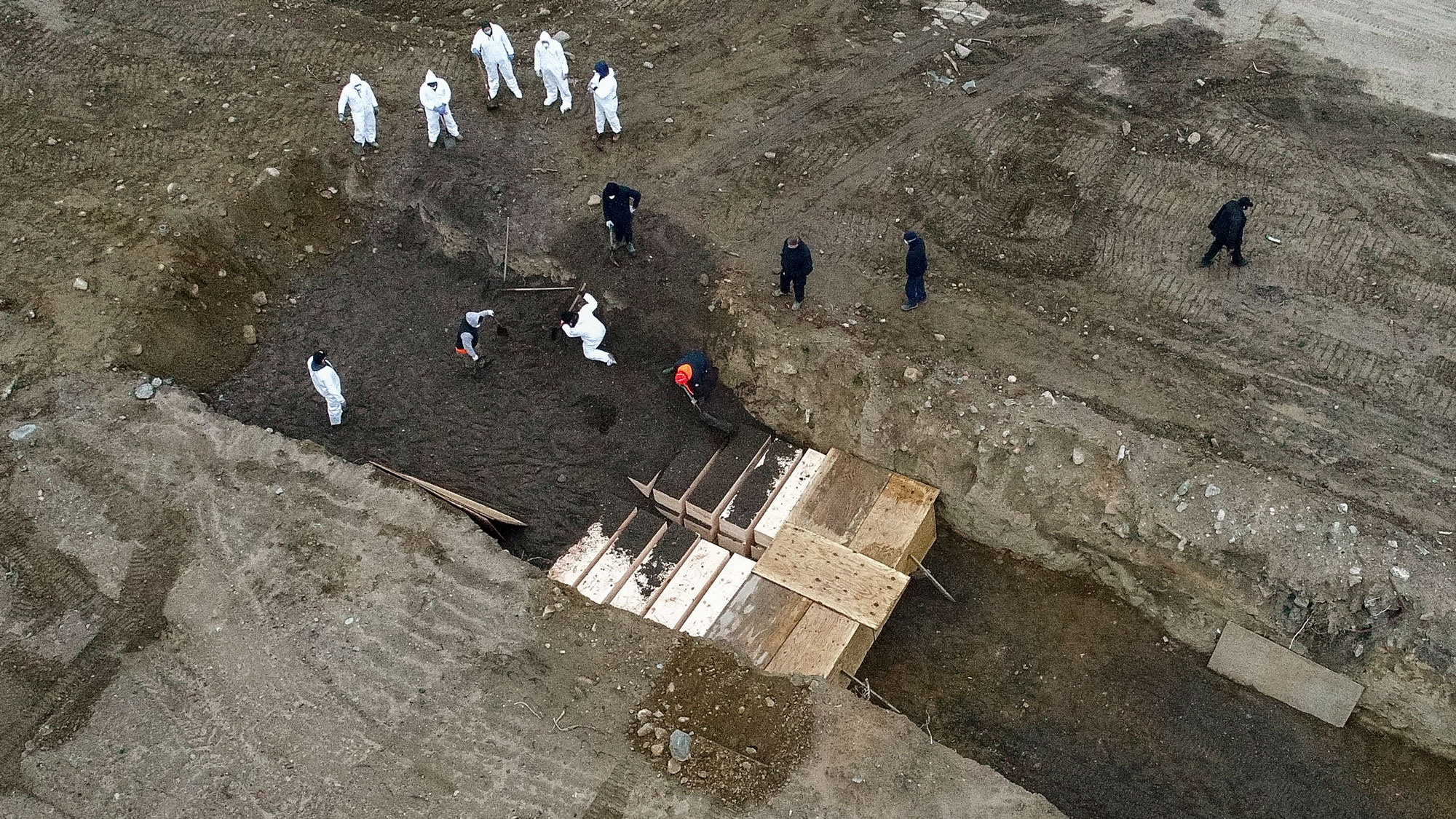 Workers bury bodies on Hart Island, a New York City public cemetery, in April.