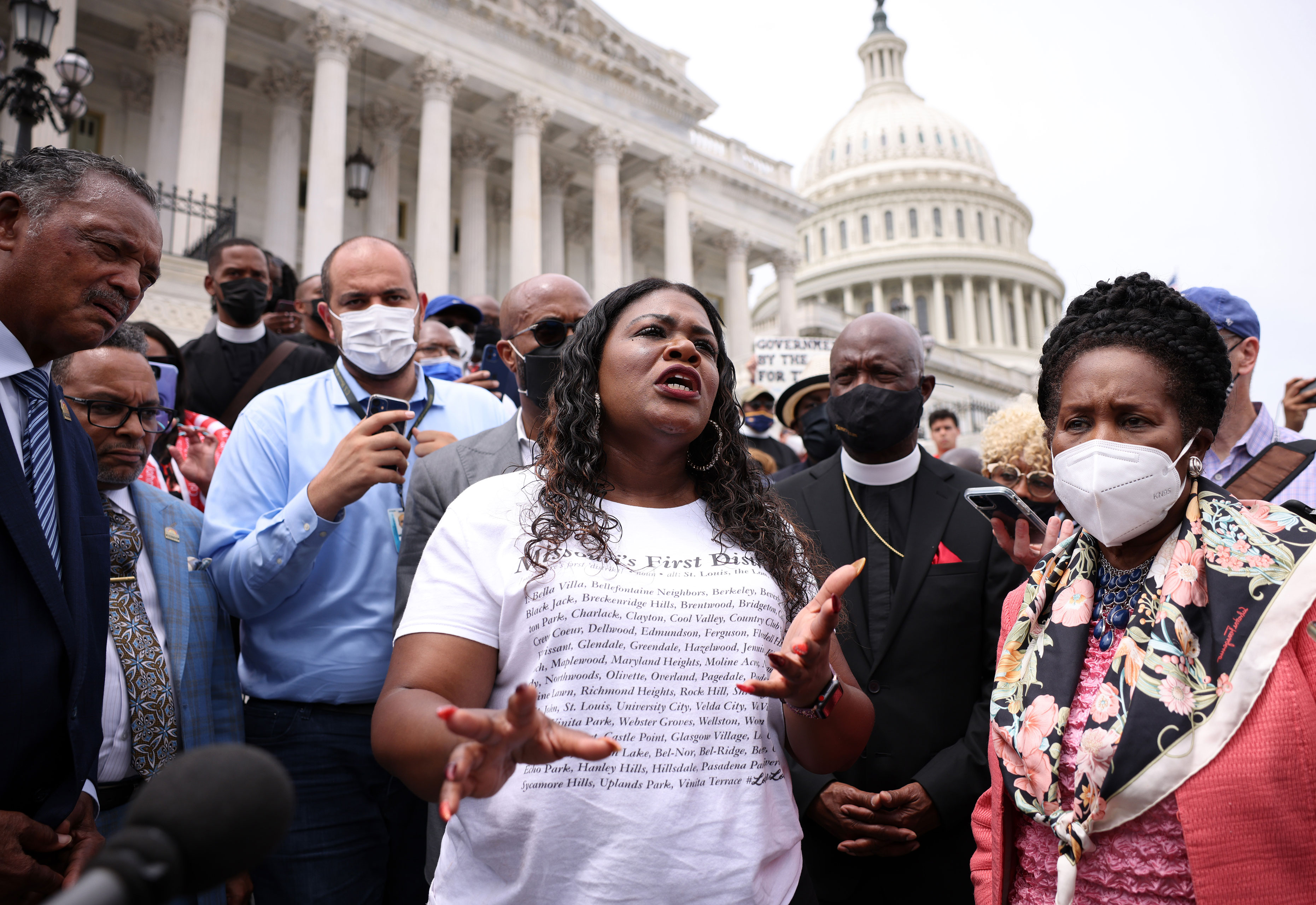 Rep. Cori Bush, center, Rep. Sheila Jackson Lee, right, and civil rights activist Jesse Jackson speak at a rally against the end of the eviction moratorium at the U.S. Capitol on Tuesday, August 3.