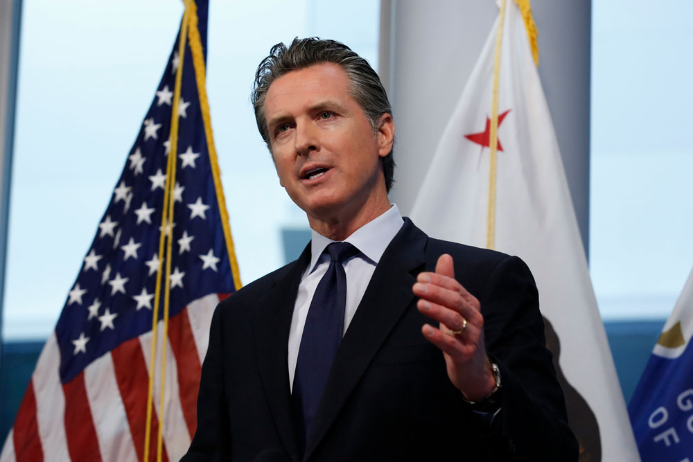 Gov. Gavin Newsom speaks at the Governor's Office of Emergency Services in Rancho Cordova, California on March 30.