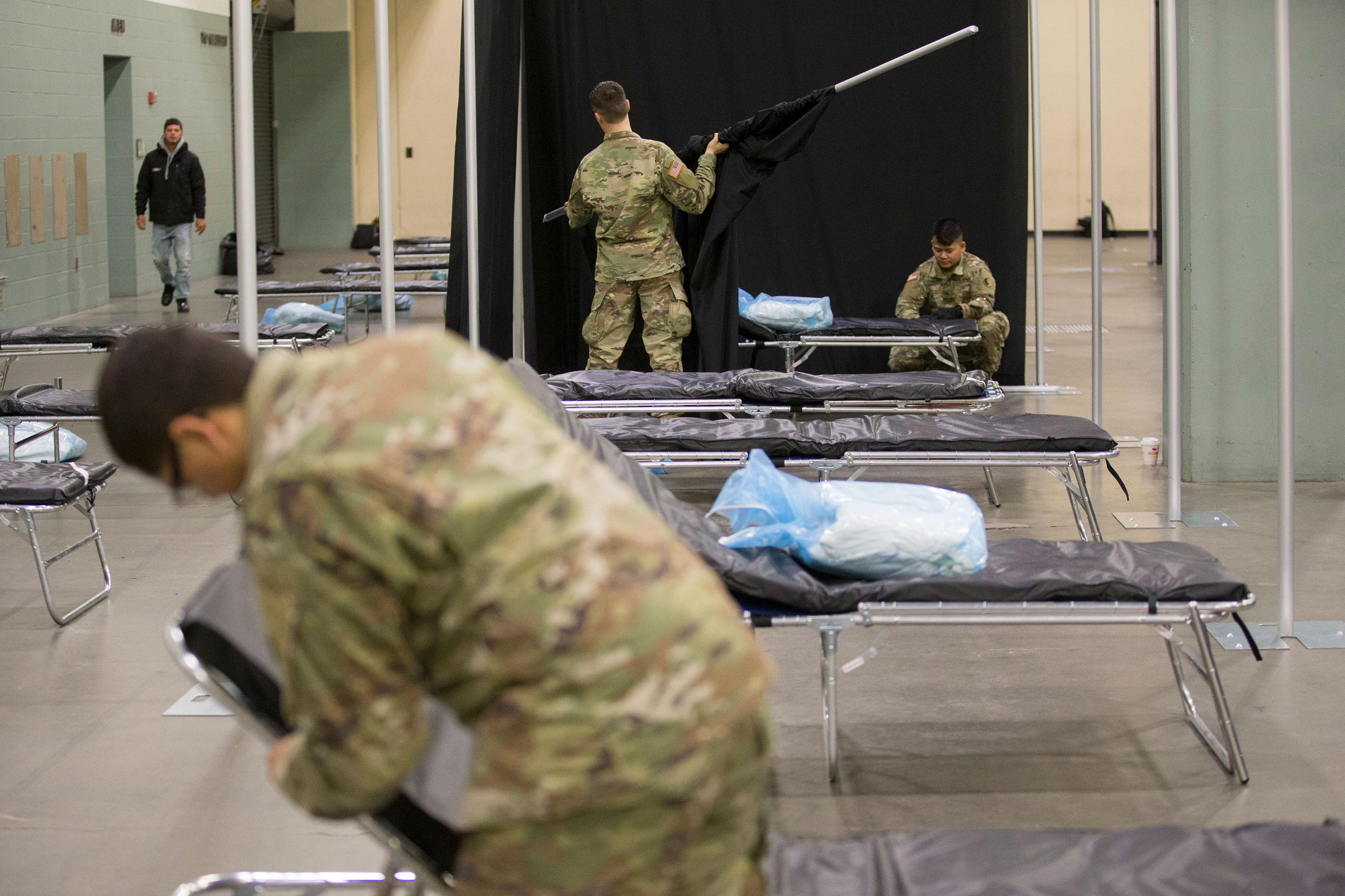 Members of the Massachusetts National Guard work at a medical field hospital at the DCU Center in Worcester, Massachusetts, on April 1.