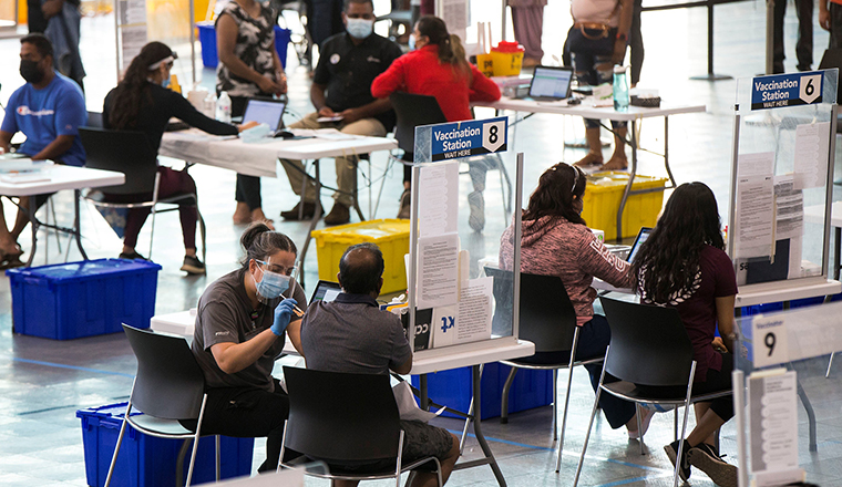 People get vaccinated at a vaccination clinic at Save Max Sports Center in Brampton, Ontario, Canada, on July 10.