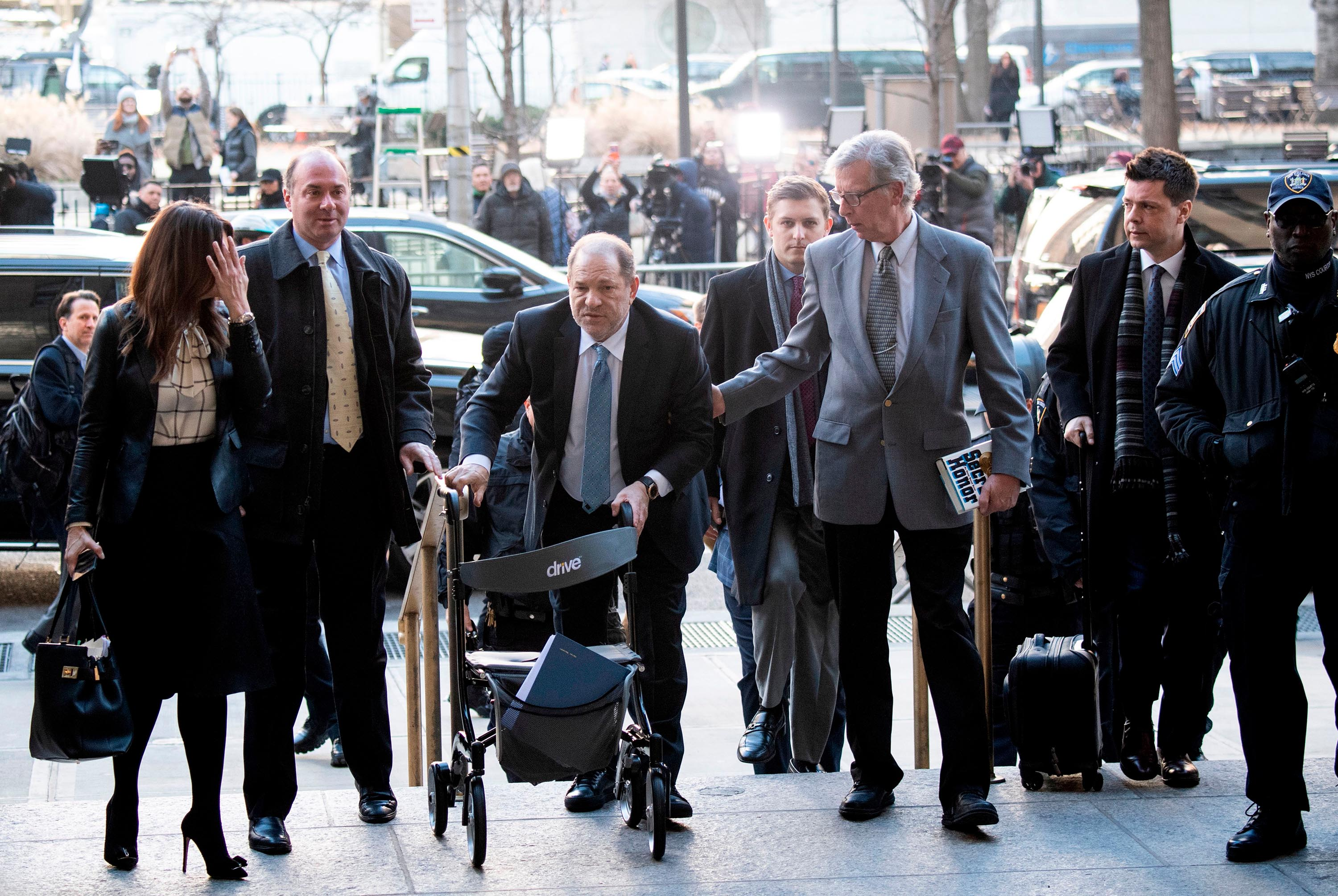 Harvey Weinstein arrives with his legal team at the Manhattan Criminal Court, on February 24, 2020 in New York City.