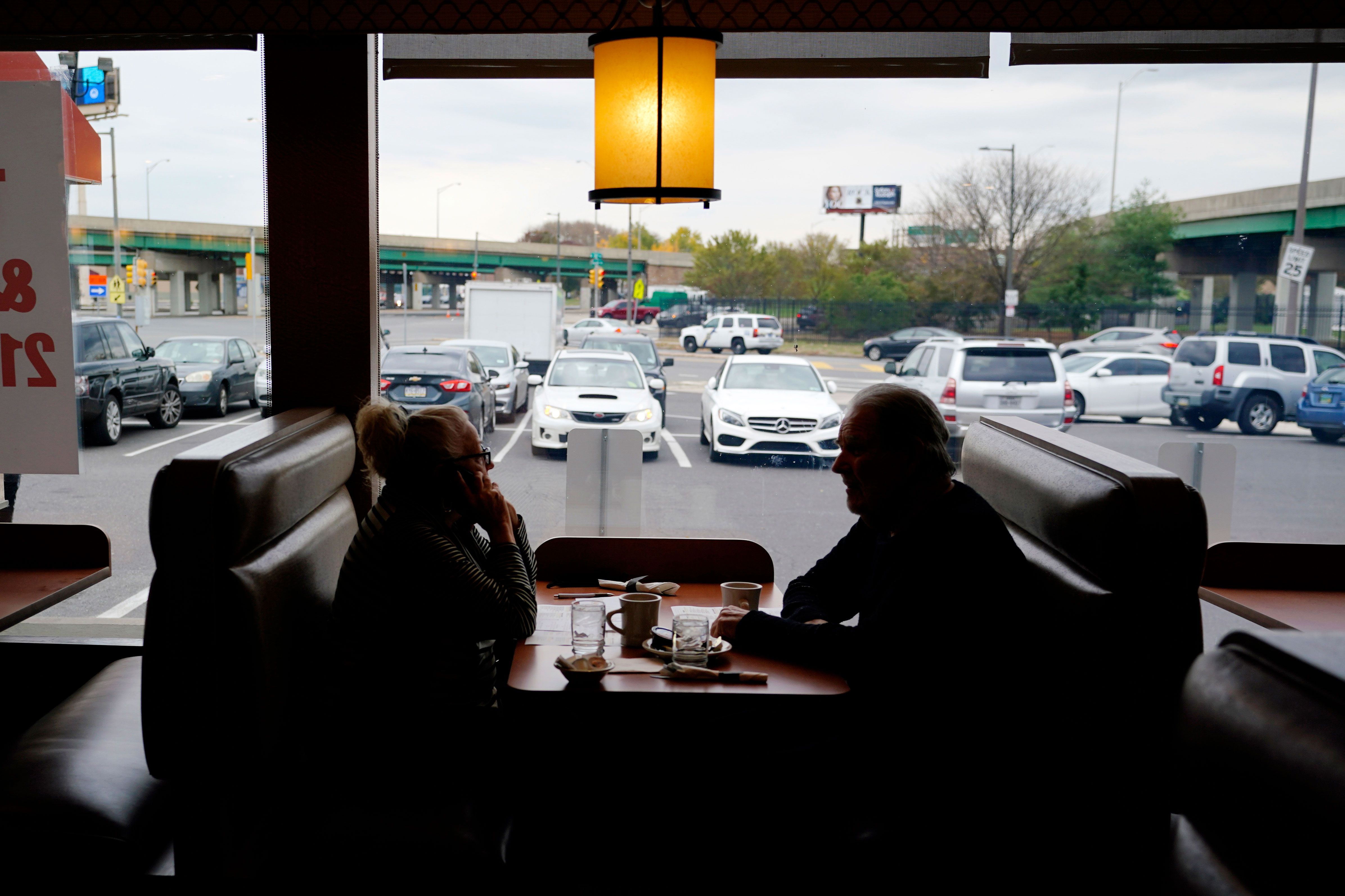 Customers sit in a booth at the Penrose Diner, on Tuesday, November 17, in south Philadelphia.