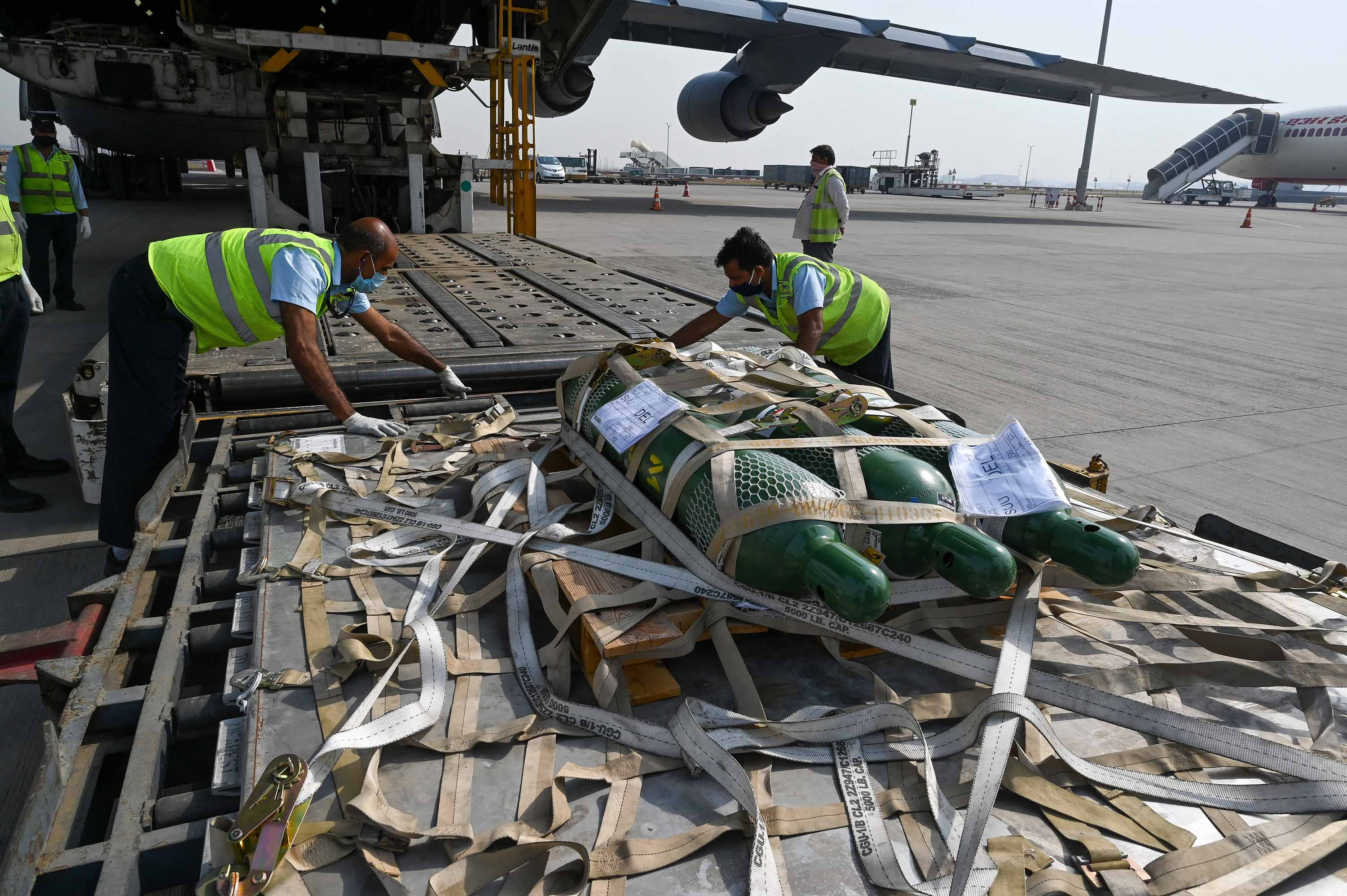 Ground staff unload Covid-19 relief supplies sent from the US, at Indira Gandhi International Airport in New Delhi, on April 30.